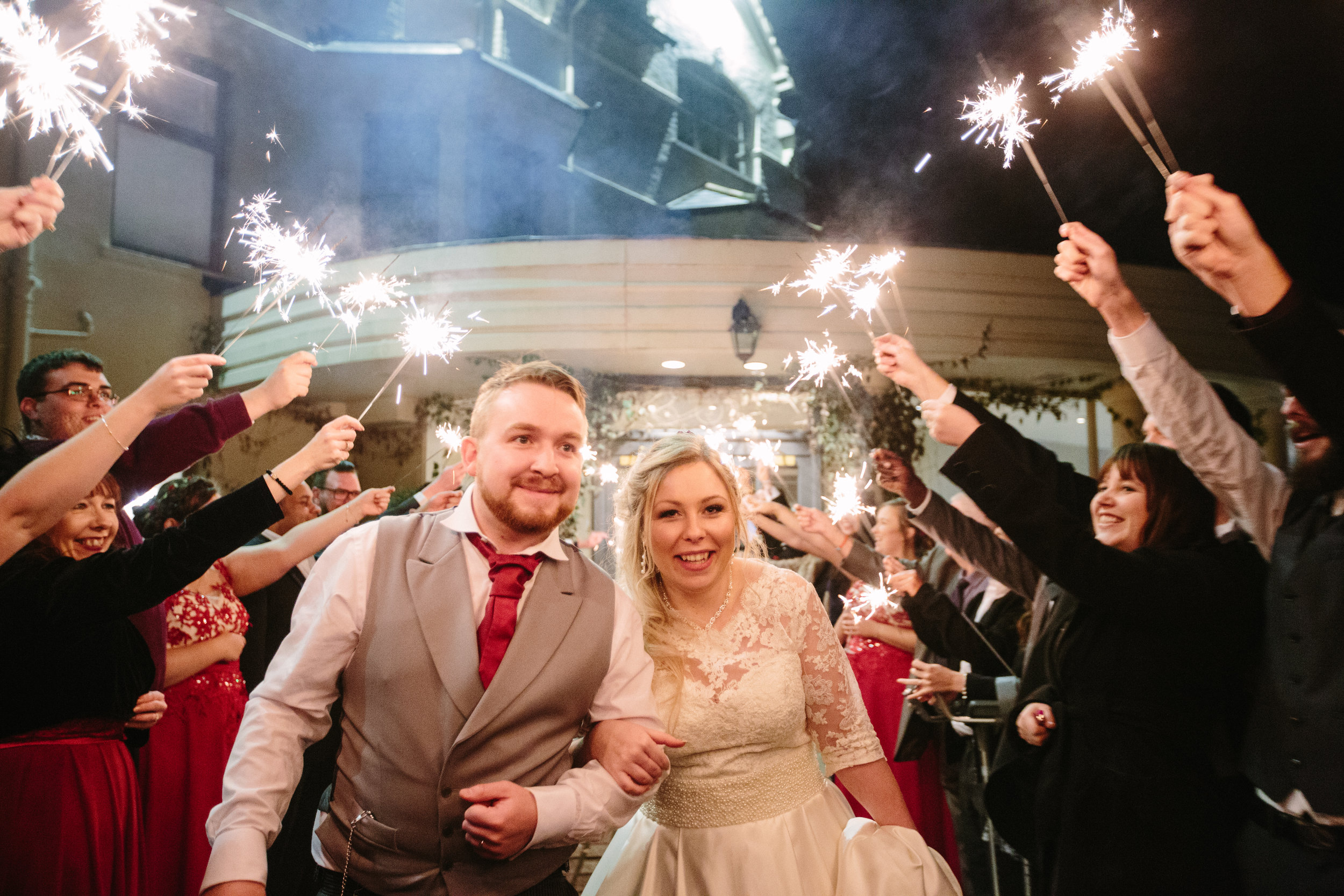 southdowns-manor-sussex-winter-wedding-photography-sparkler-arch-90