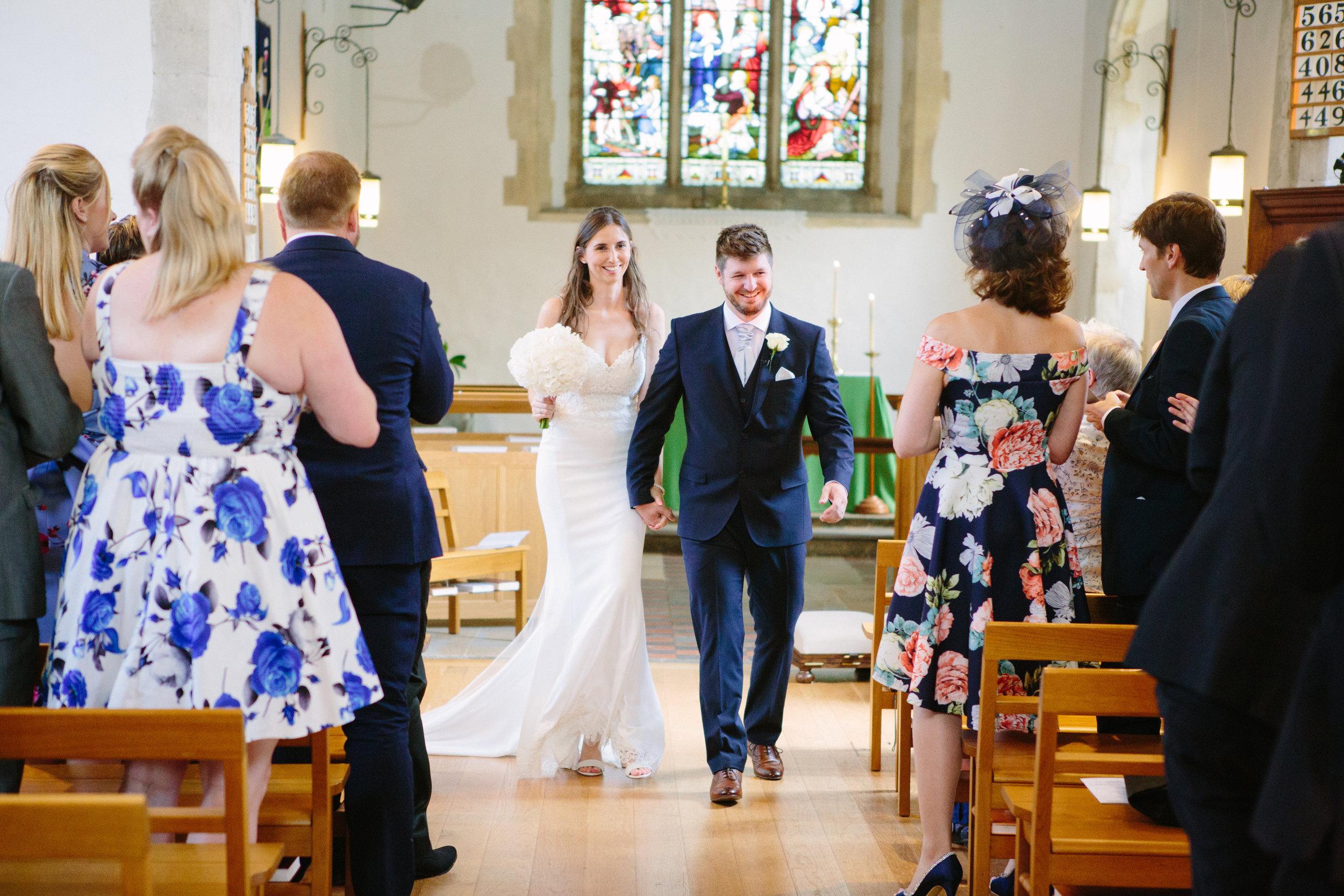 kent-wedding-photography-kingsnorth-church-bride-groom-aisle-01