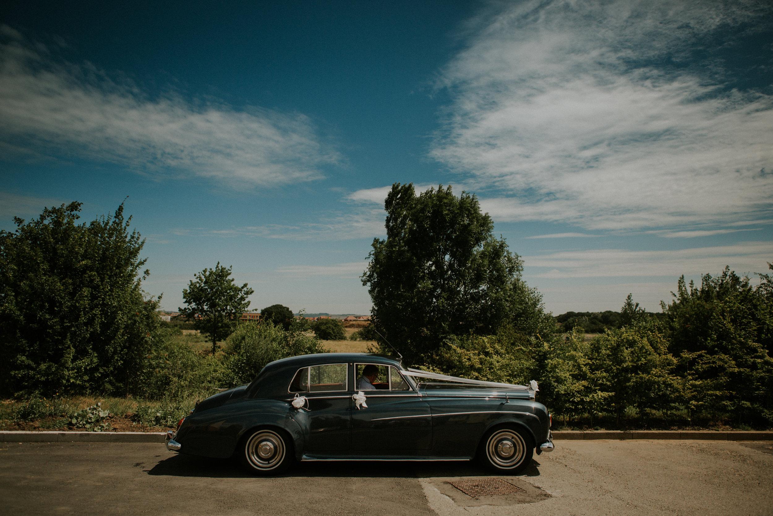 kent-wedding-photography-kingsnorth-bridal-car-02