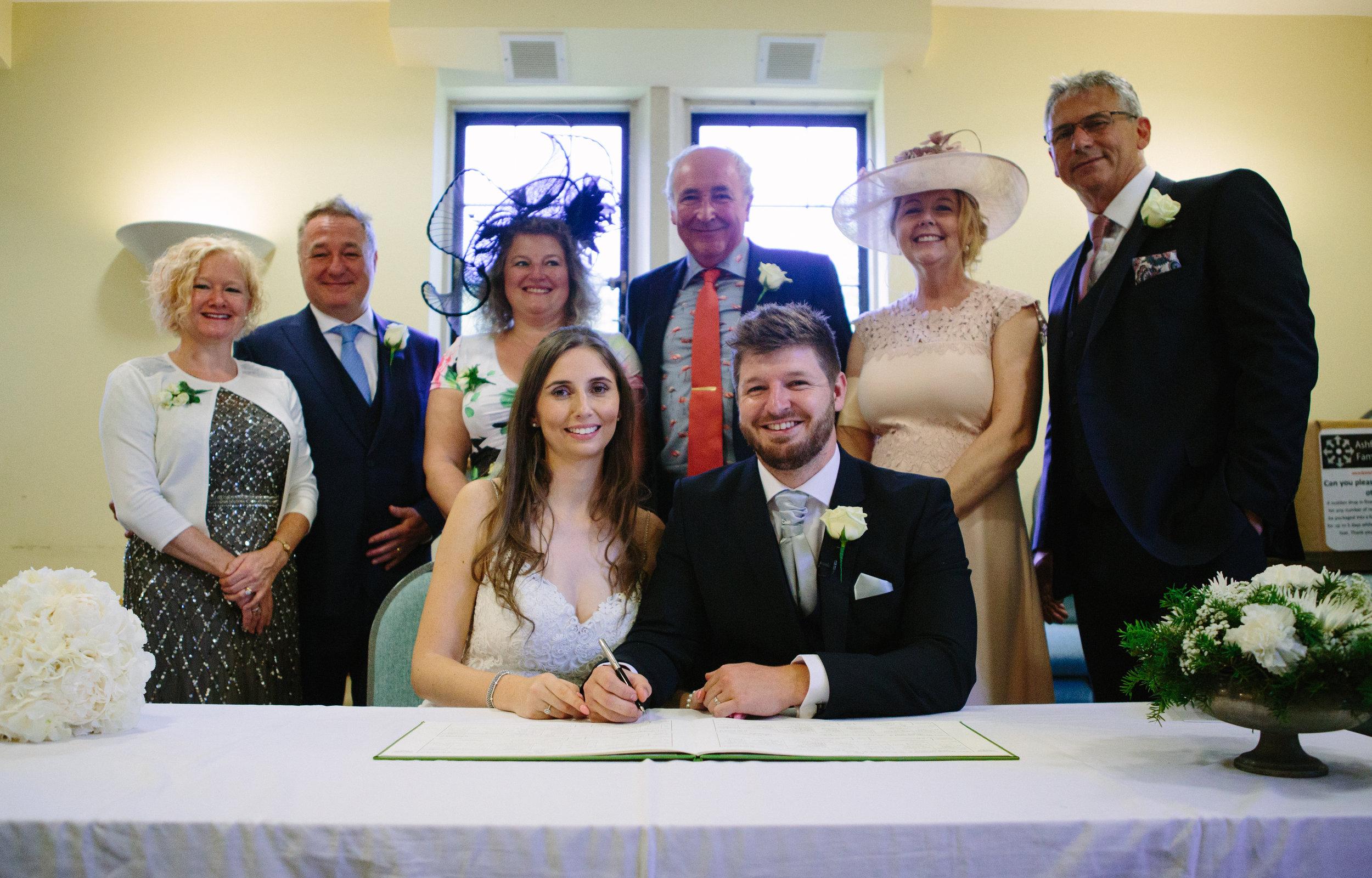 kent-wedding-photography-kingsnorth-signing-register-41