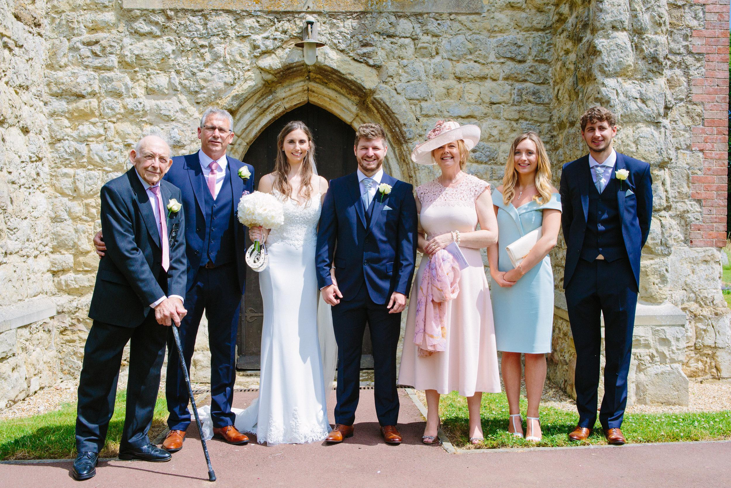 kent-wedding-photography-kingsnorth-church-group-shot-45