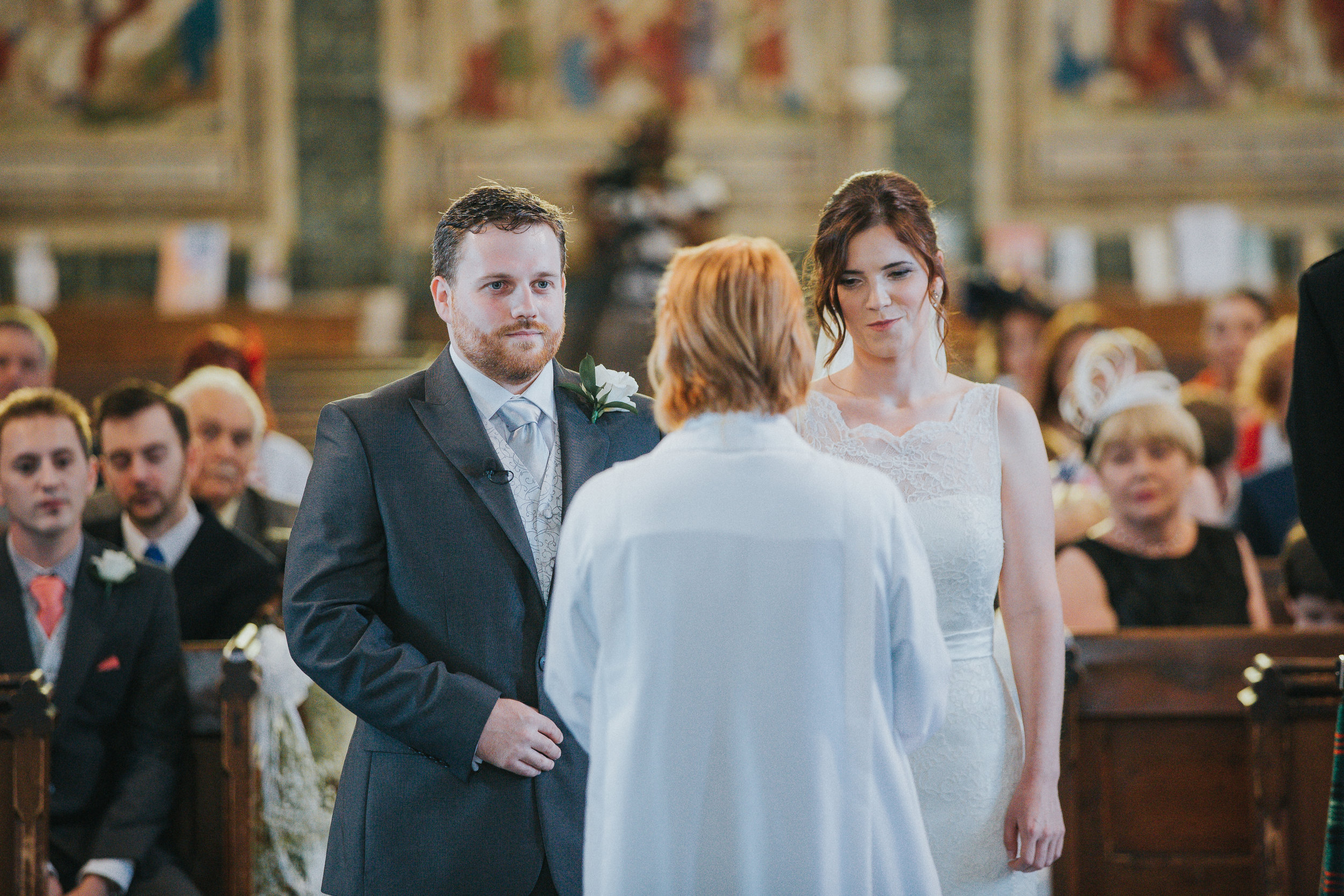 reigate-surrey-london-wedding-photography-vicar-altar-marrying-39