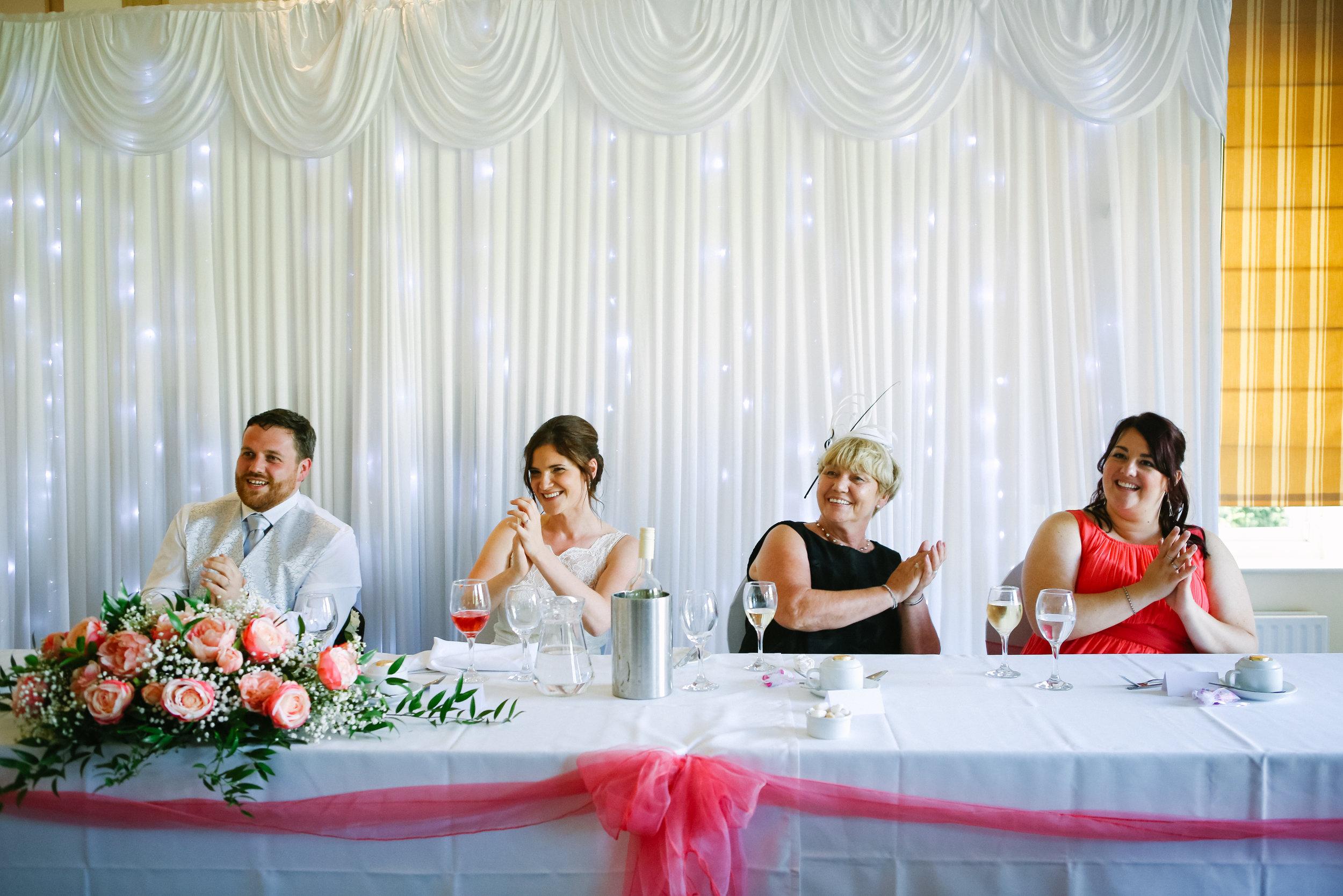 reigate-surrey-london-wedding-photography-group-formal-shot-reception-woldingham-golf-club-singing-waiter-85