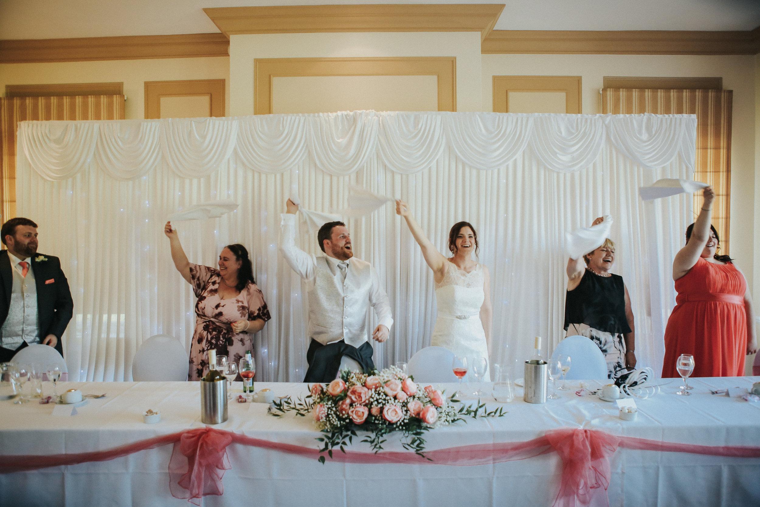 reigate-surrey-london-wedding-photography-group-formal-shot-reception-woldingham-golf-club-singing-waiter-90