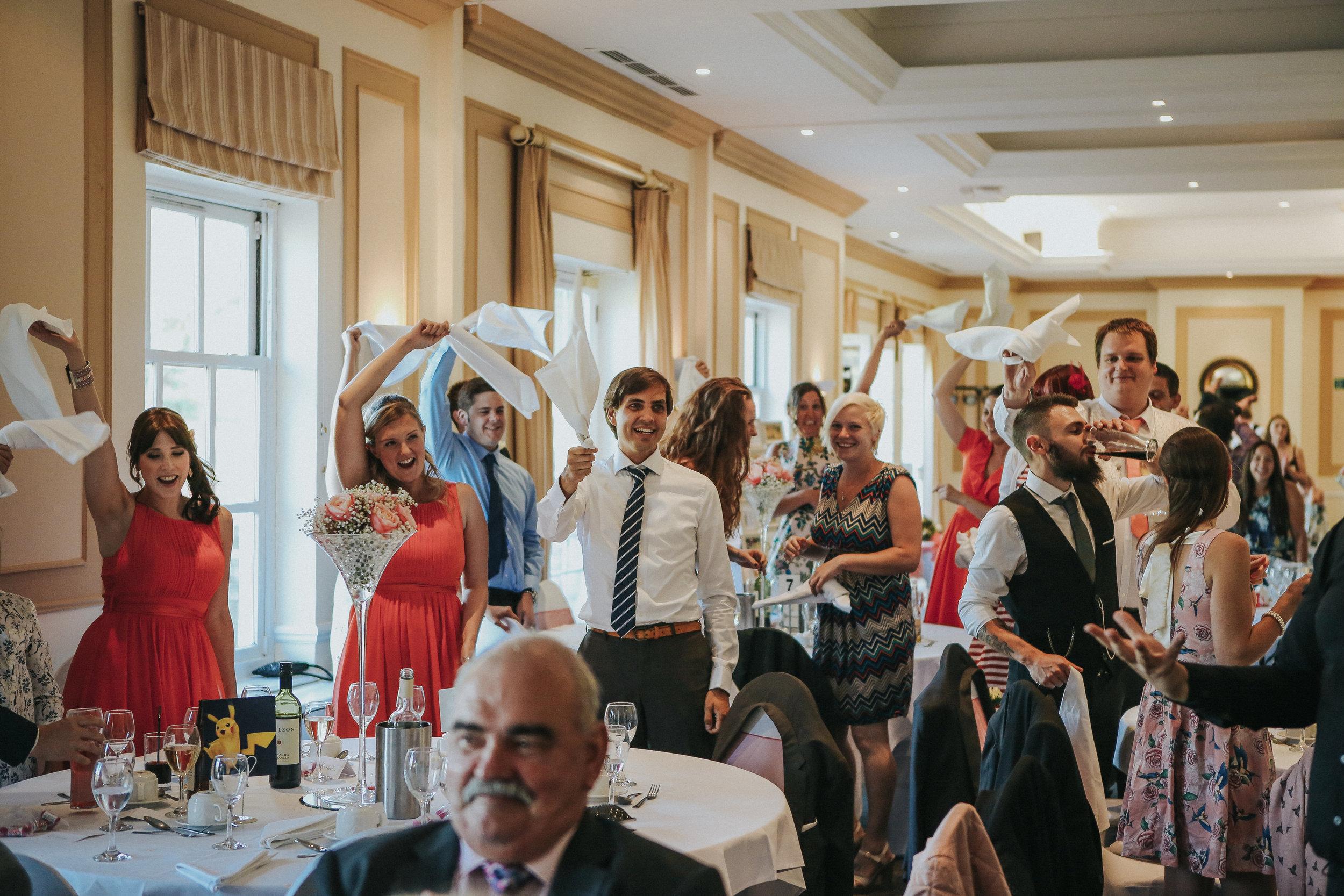 reigate-surrey-london-wedding-photography-group-formal-shot-reception-woldingham-golf-club-singing-waiters-97