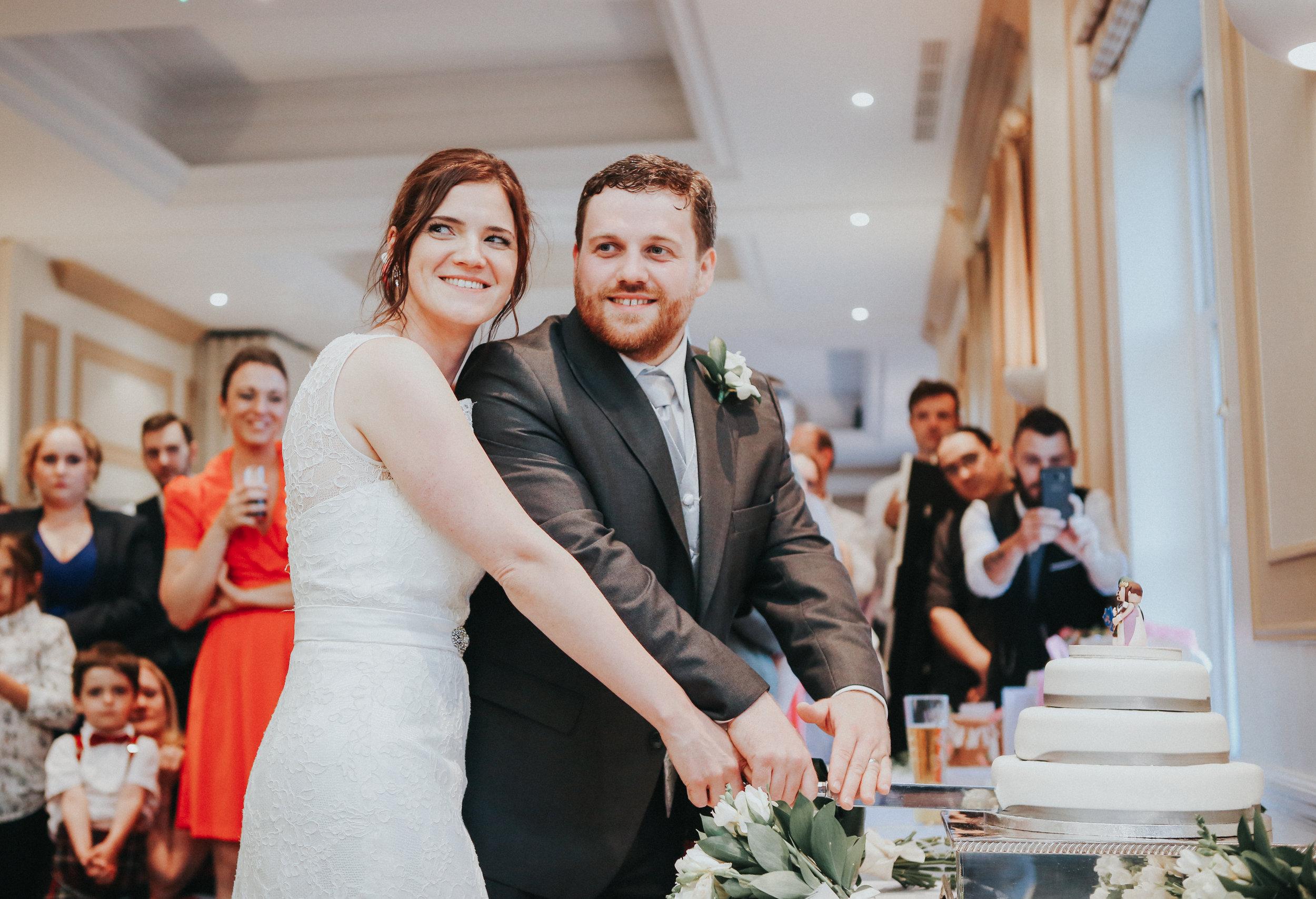 reigate-surrey-london-wedding-photography-group-formal-shot-reception-woldingham-golf-club-bridal-portrait-cake-cut-107