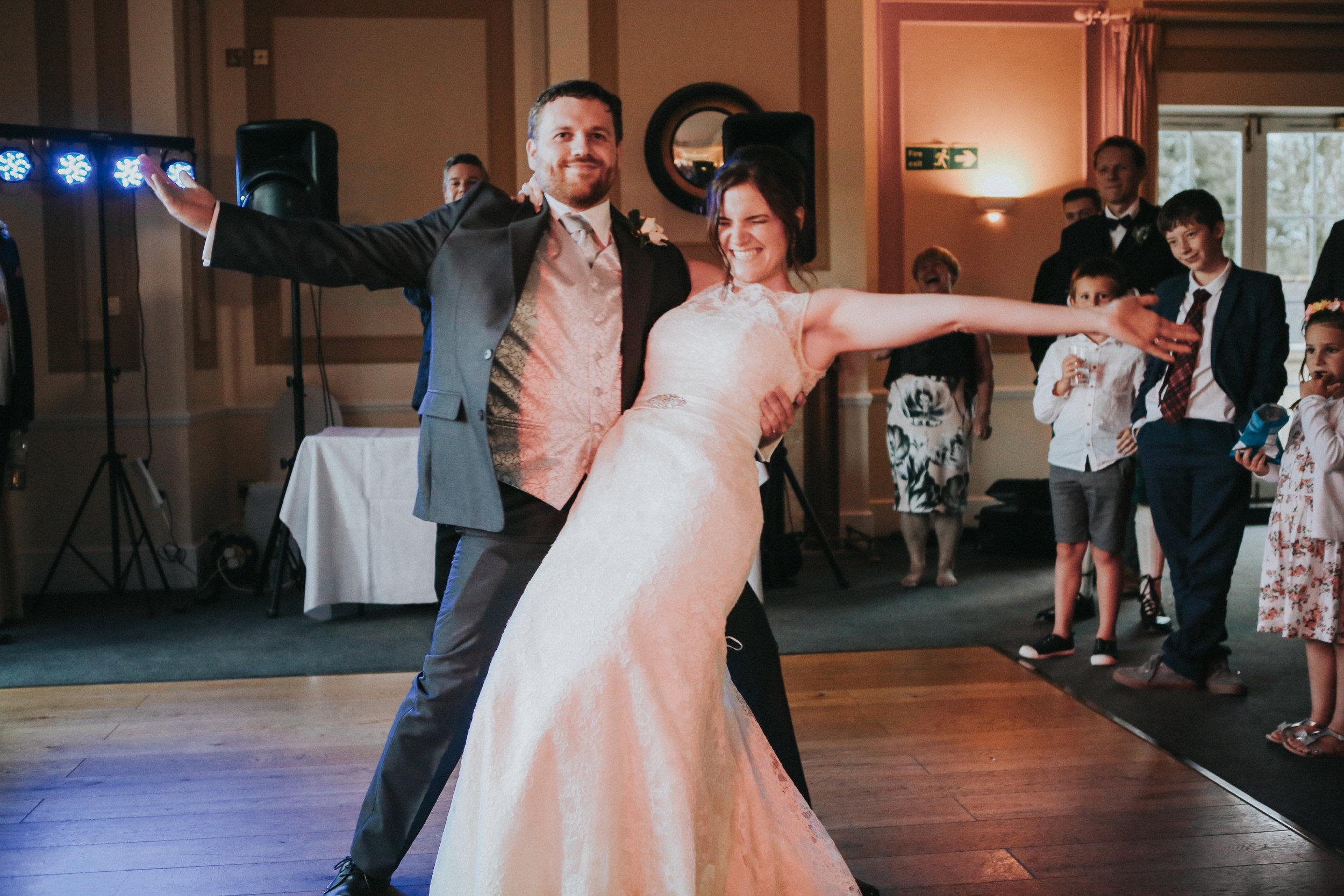reigate-surrey-london-wedding-photography-group-formal-shot-reception-woldingham-golf-club-first-dance-109