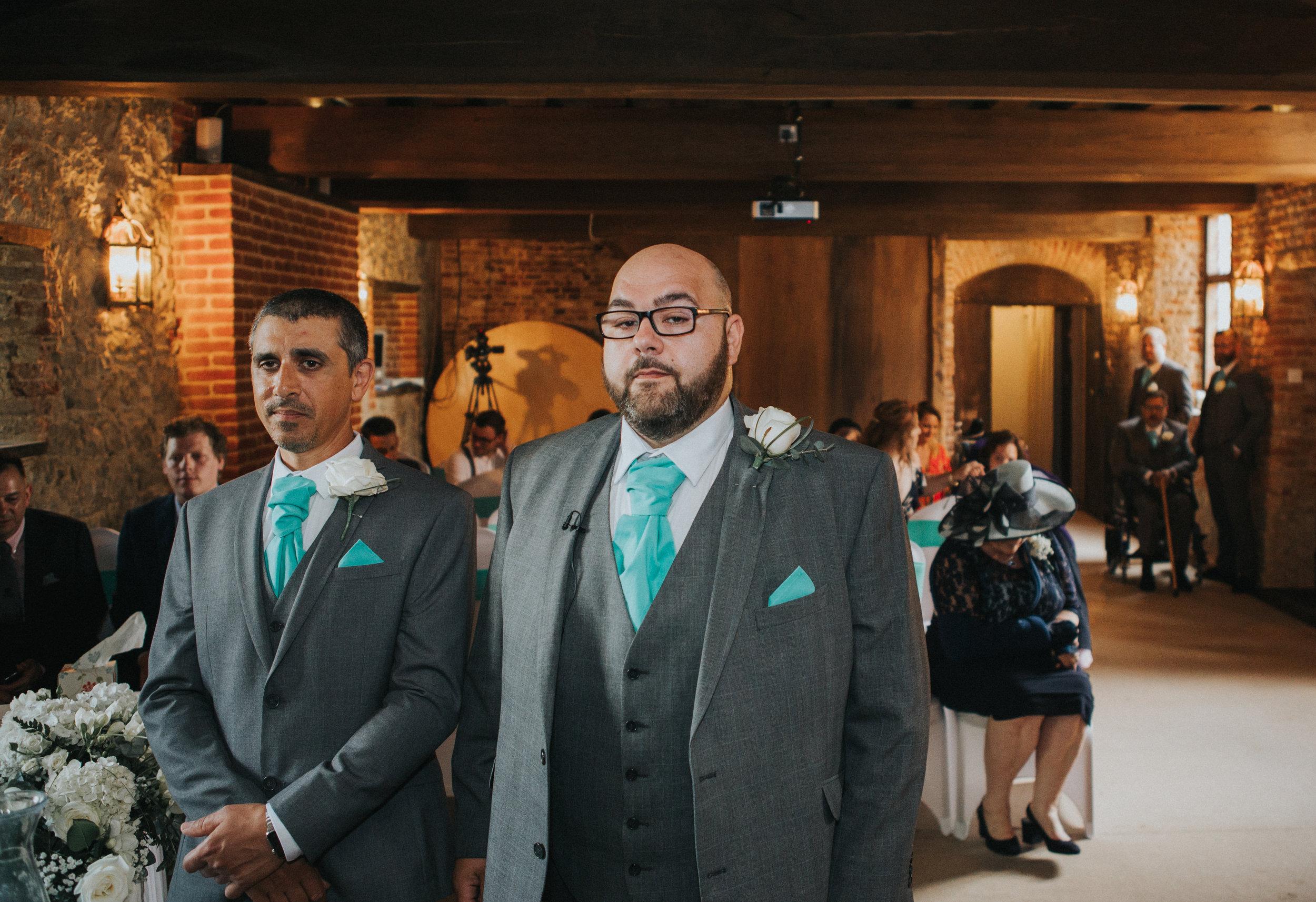 westenhangar-castle-kent-london-wedding-photography-groom-aisle-wait-34