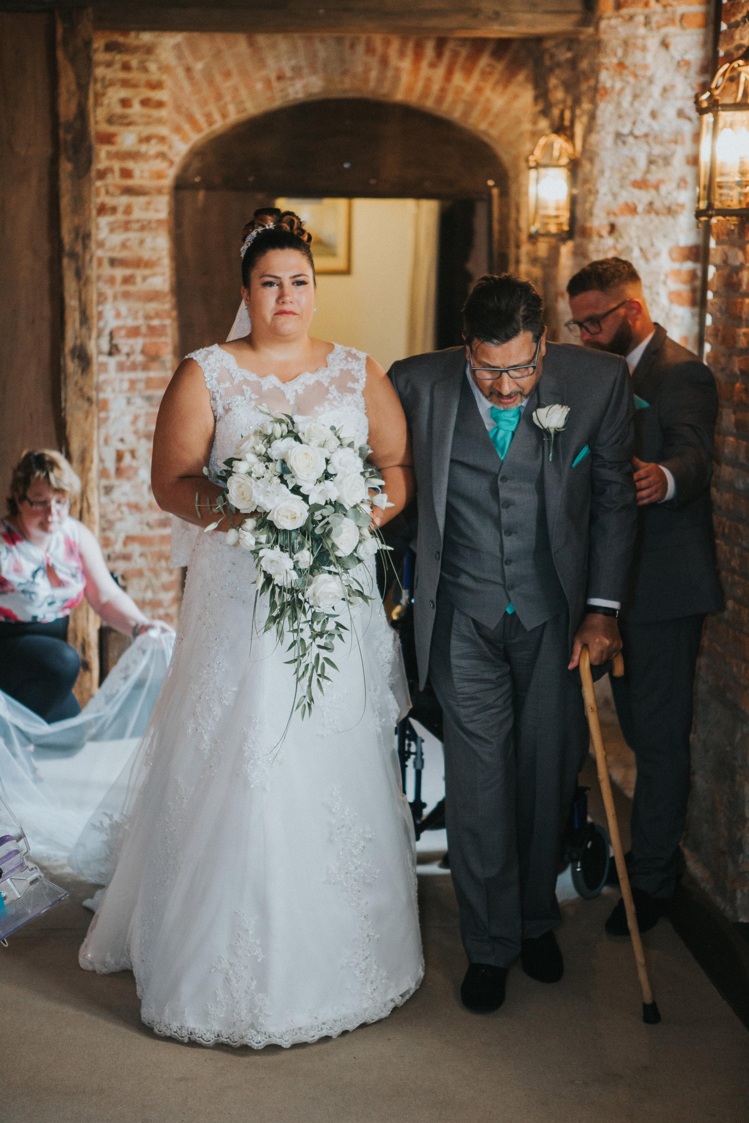 westenhangar-castle-kent-london-wedding-photography-bride-aisle-35