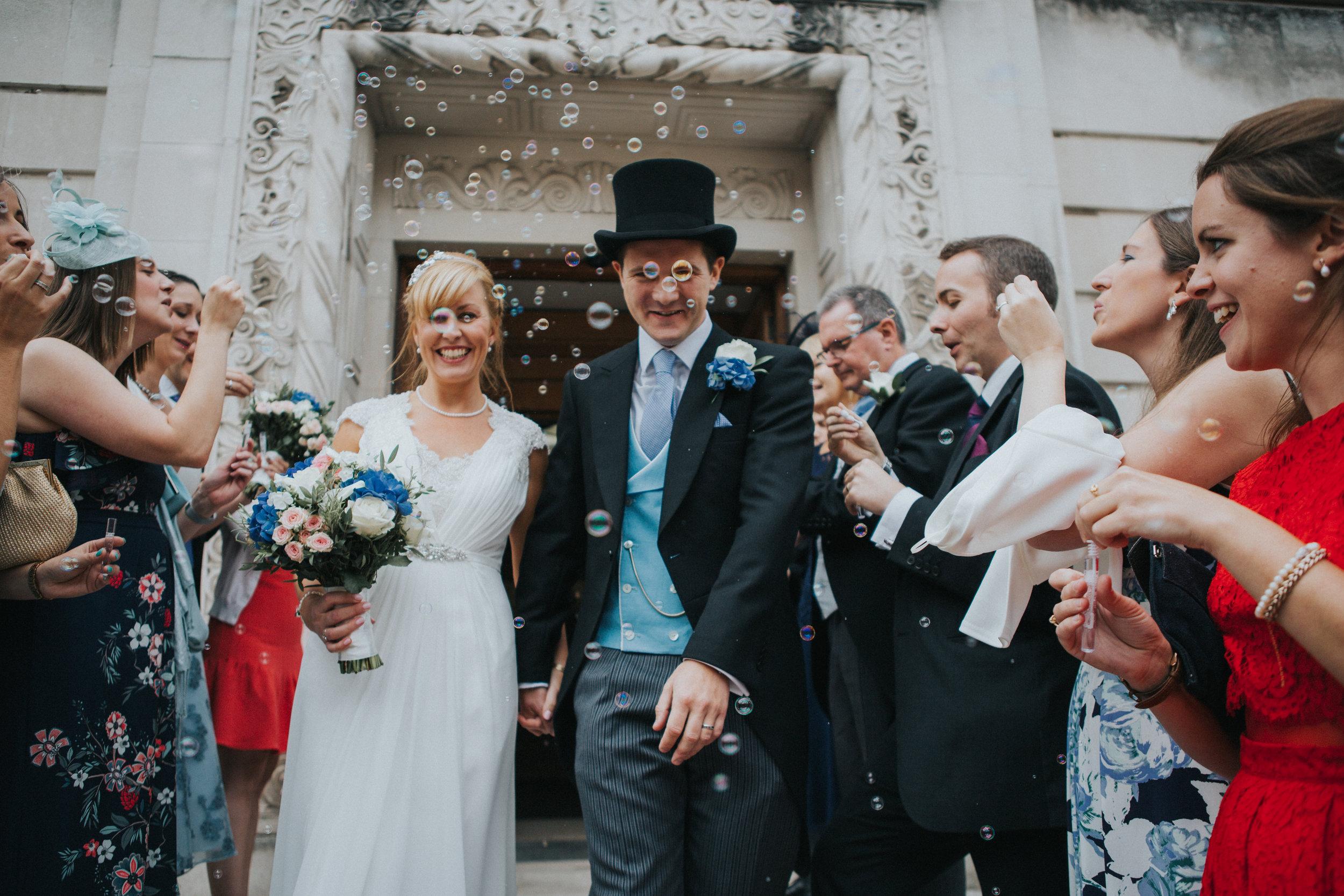 london-wedding-photography-wimbledon-wandsworth-town-hall-savoy-hotel-bubble-confetti-arch-51
