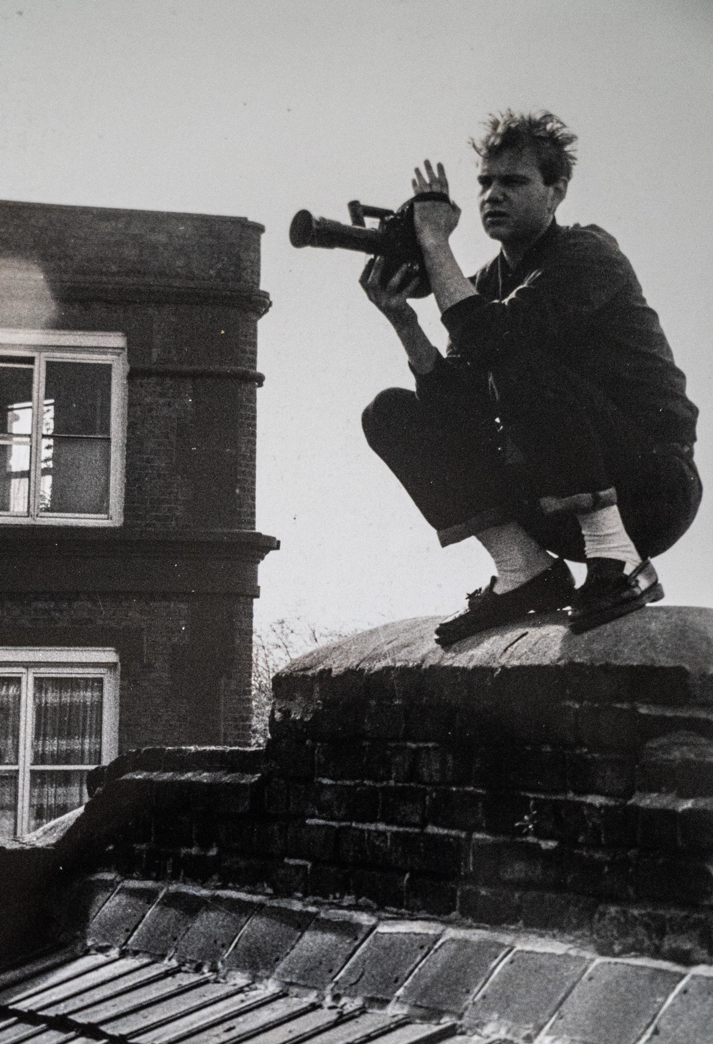- SO THIS WAS ME BACK IN THE DAY…That's how long I've been addicted to telling stories with a camera, back when loafers with white socks, rolls of celluloid film and prancing about on Camden rooftops were first in fashion.I tried being the straight guy, working for all those broadcasters and corporations. Ten long and often fun years of travelling the world shooting. But it just wasn't me. The offices. The desks. The politics.What was me? Turns out, 'me' is shooting the mad stuff, the bad stuff, the crazy stuff, the funny and the sad stuff. And yes, the simple and traditional stuff. The essential human stuff. YOUR stuff.