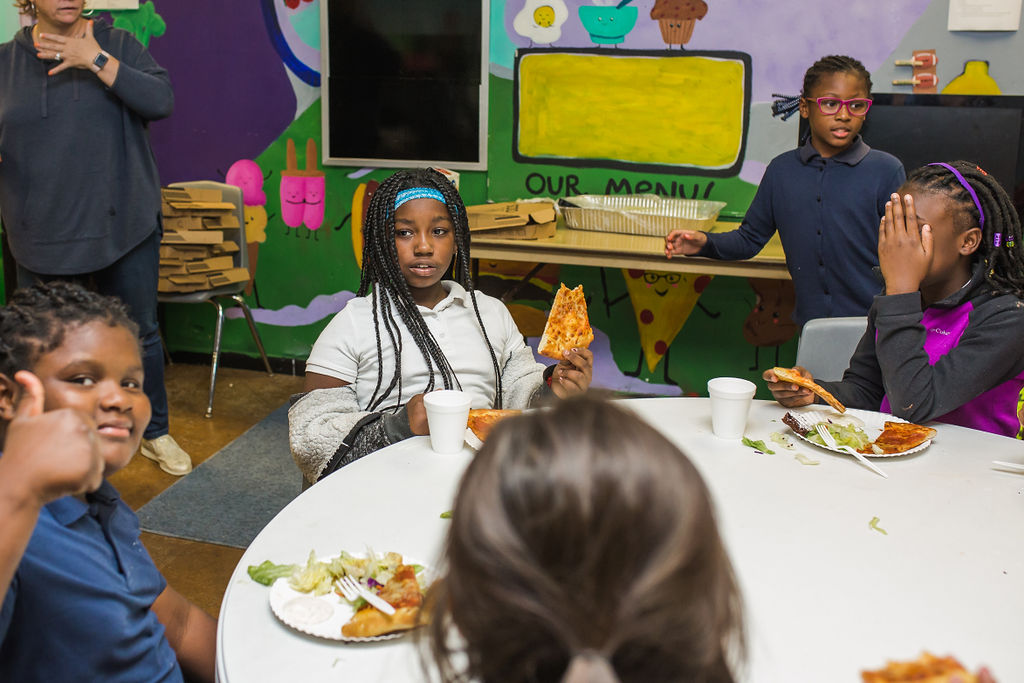 Students in After School enjoy snack and dinner, homework help, and extracurricular activities.