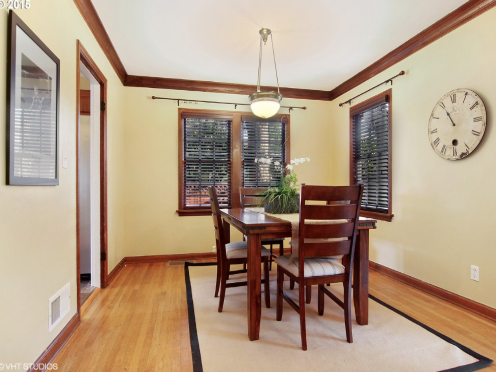 After: After removing the doors and large cabinets, the room feels instantly lighter, brighter and is now understandably a  dining room . We chose to leave the window treatment hardware for the buyers, but normally I would have them removed to leave clean crisp windows.