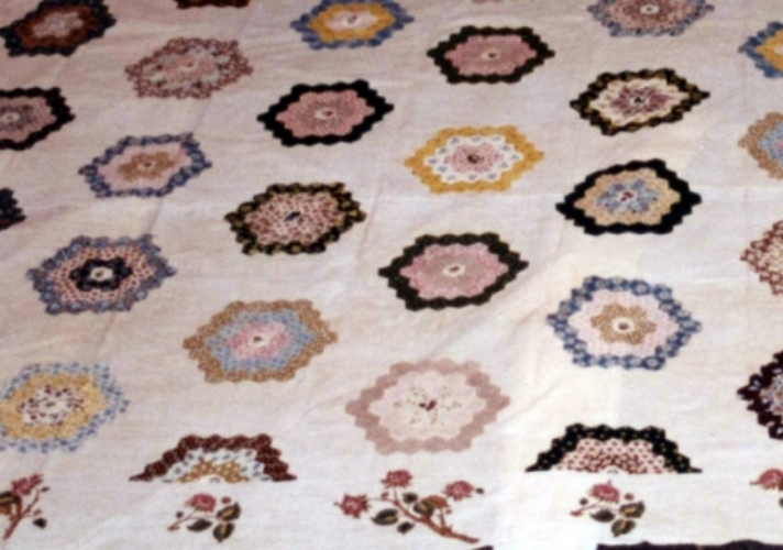 This quilt, the oldest in the Museum's collection, was made by Maria Victor in 1802. It has a cotton muslin base with quilted sections and some applique areas.