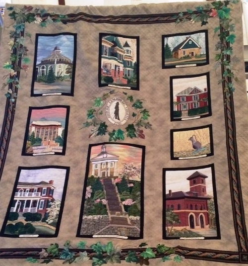 """This quilt is titled """"Vintage Landmarks: Lynchburg, Virginia"""". It was designed and made in Lynchburg by Frances B. Calhoun from 1998-1999. It features several prominent and historic Lynchburg landmarks."""