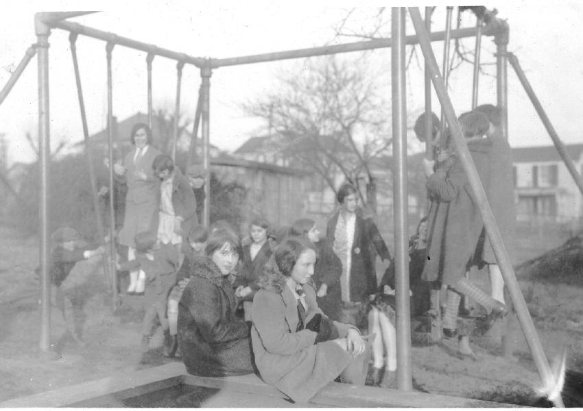 Children play on the swing set at Guggenheimer-Milliken, 1924.