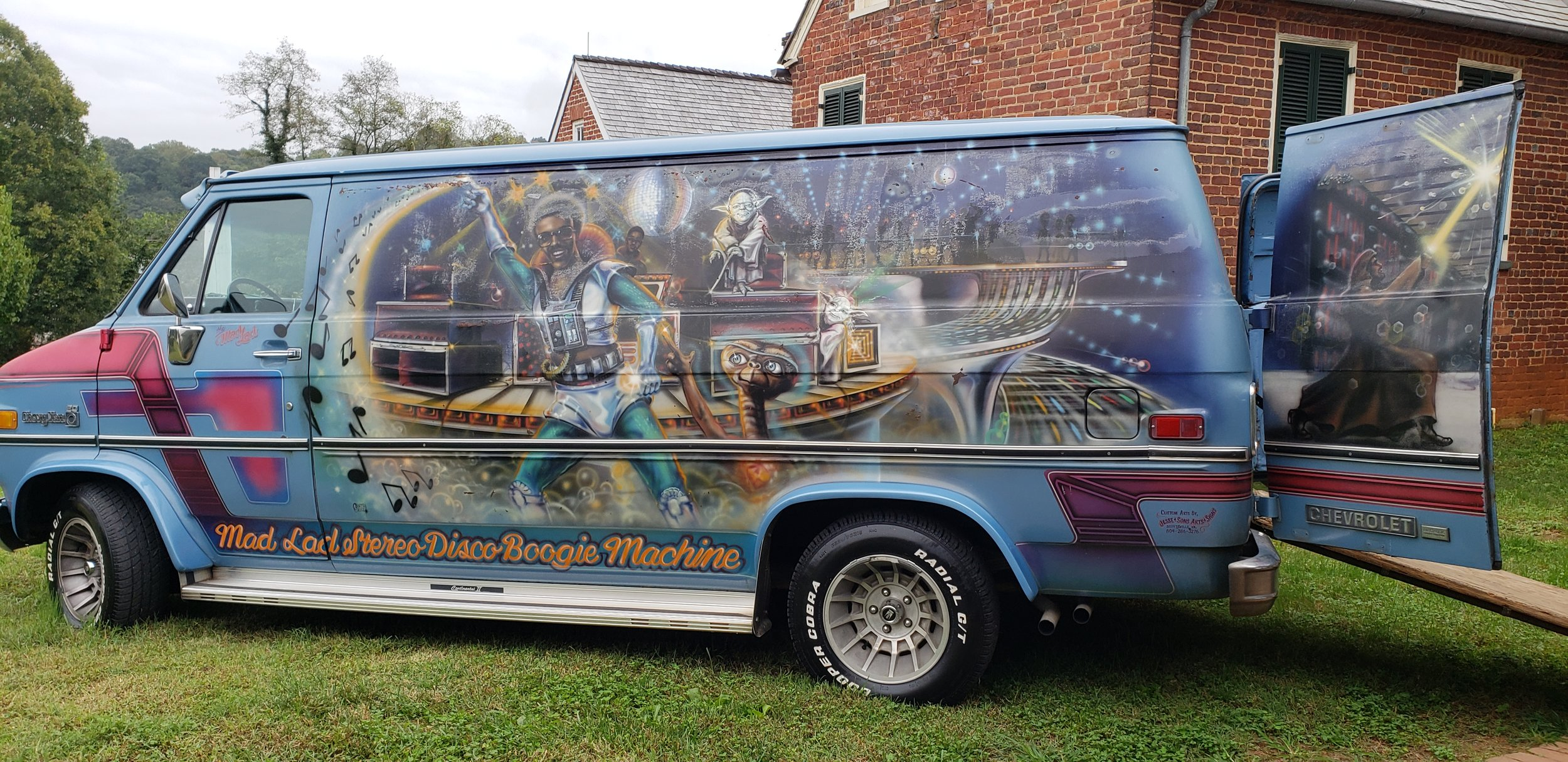 A recognizable van with an image of Goins painted on the side.