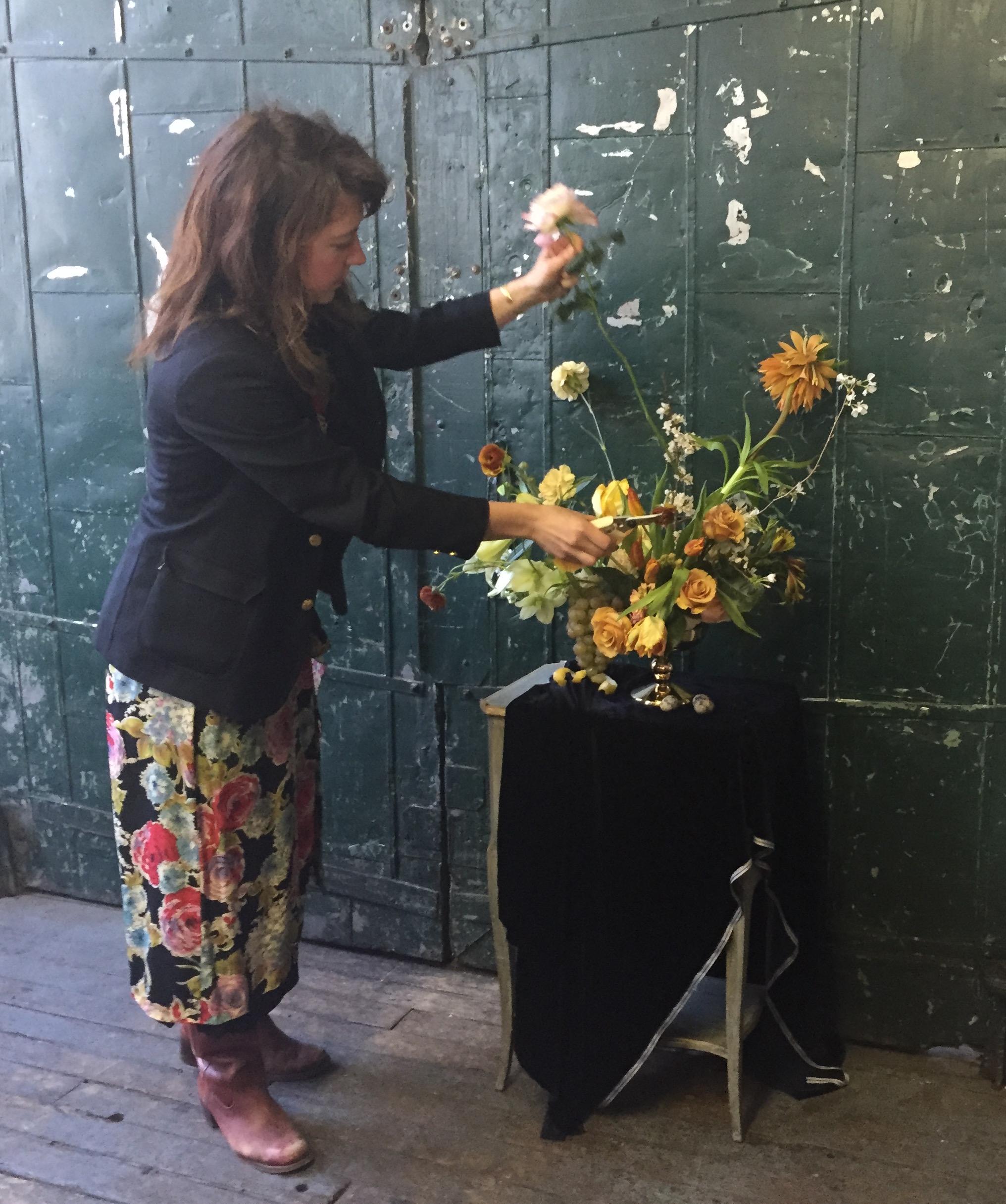 Saipua founder Sarah Ryhanen making flower arrangement