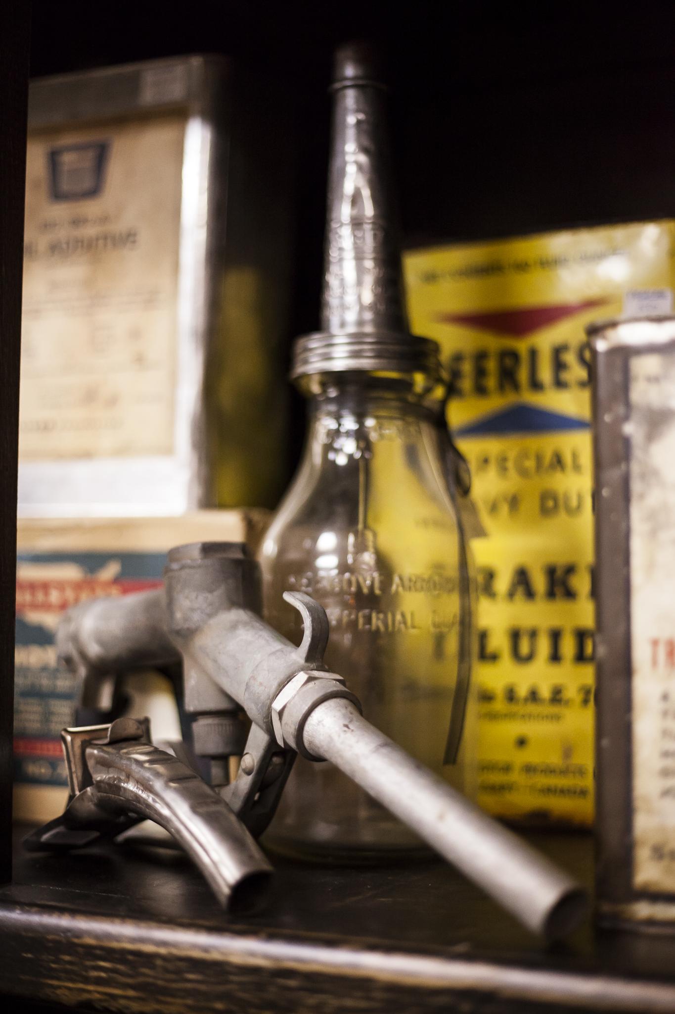 Antique Gas Pump Nozzles, Glass Oil Jars, Auto Parts