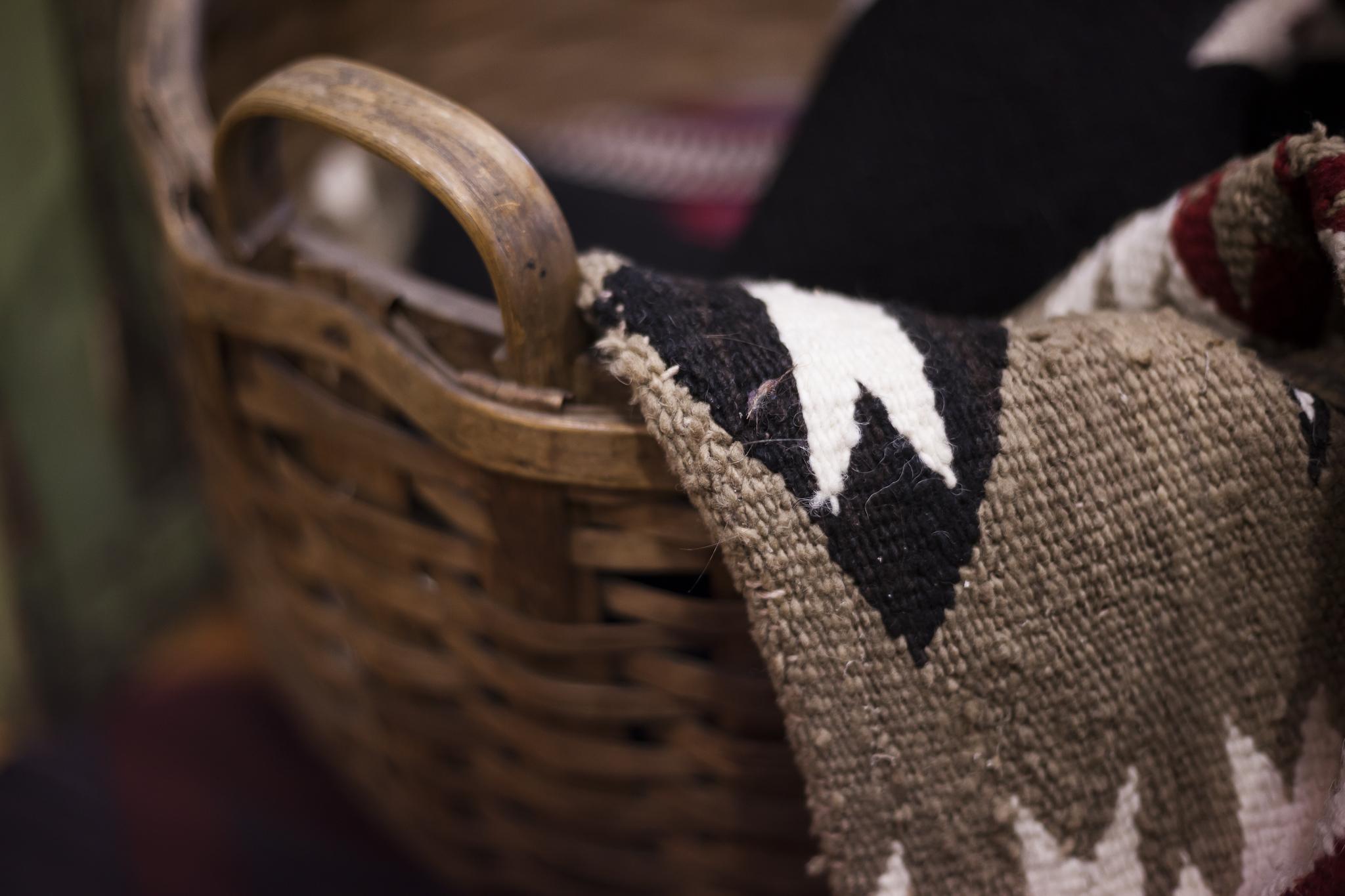 Primitive Indian Blanket in a Wicker Basket