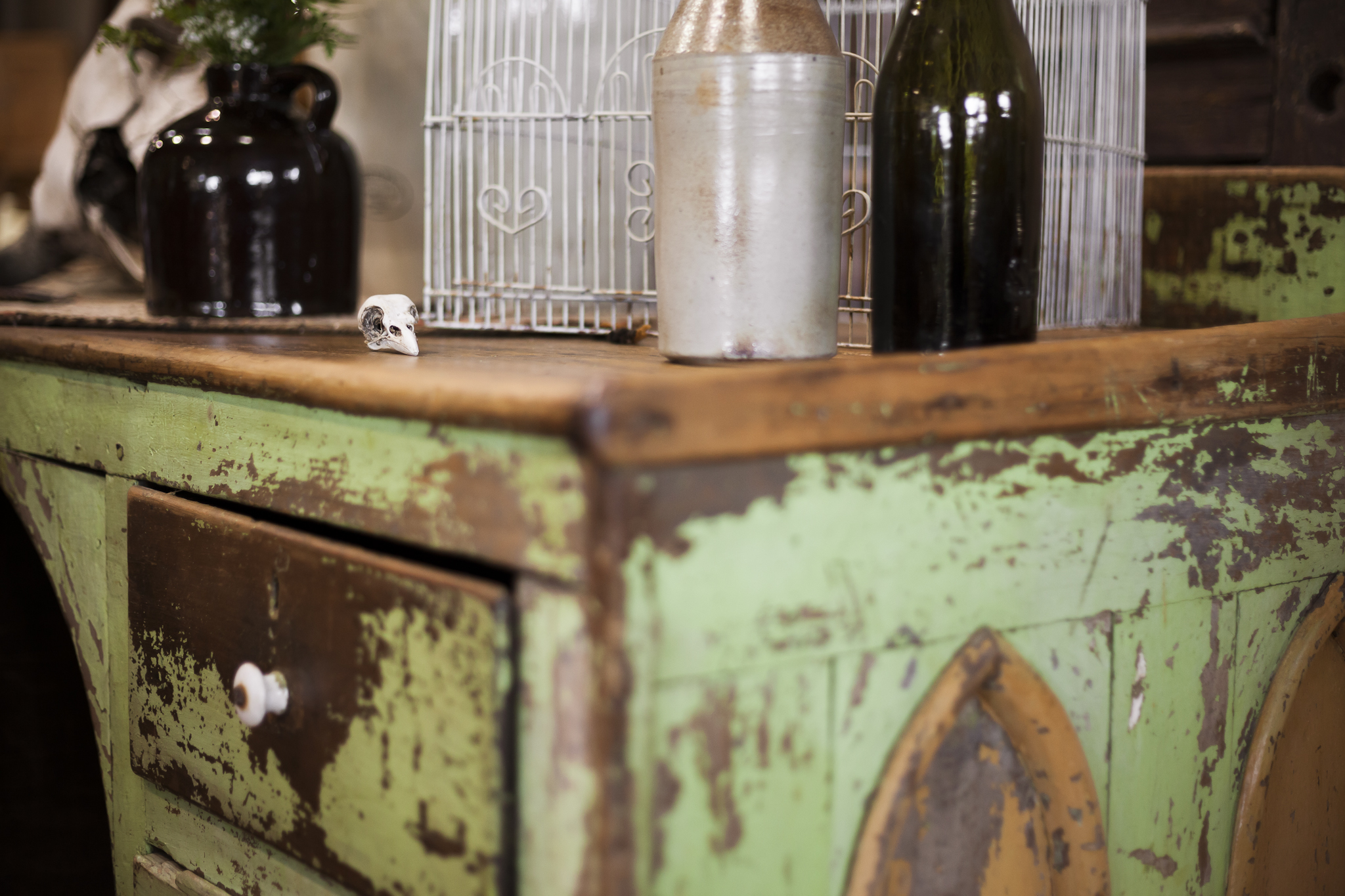 Aged Antique Desk with Milk Bottles, Baby Crow Skull and Birdcage On Top.
