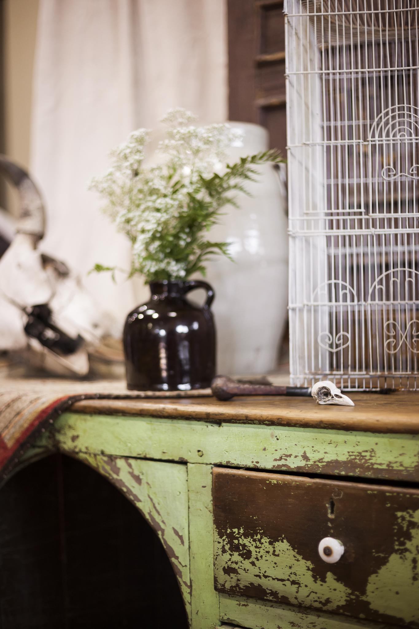 Aged Skull and Vintage Vase on a Distressed Old Desk