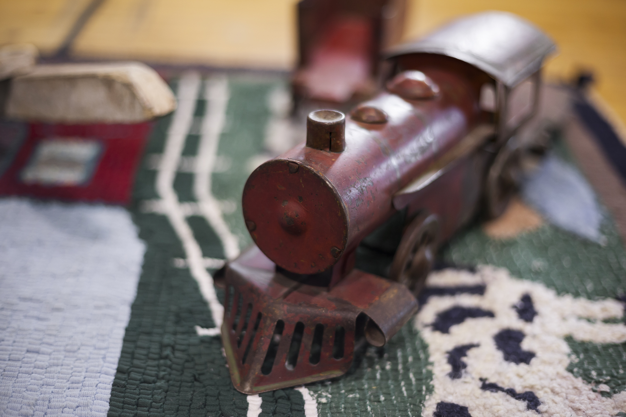 Hand Carved Wooden Train on a Woven Children's Cow Blanket