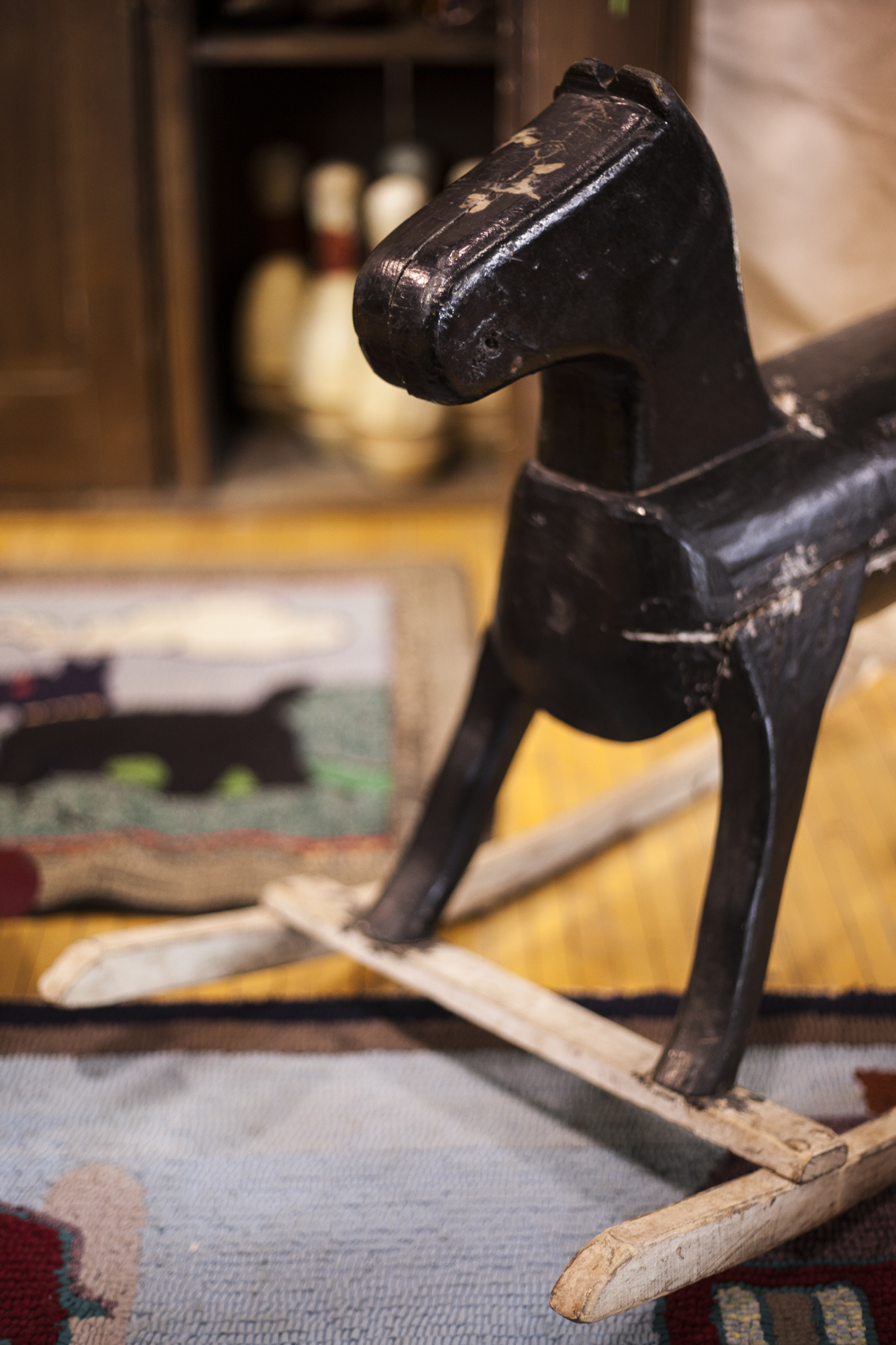 Antique Children's Rocking Horse and Play Rugs