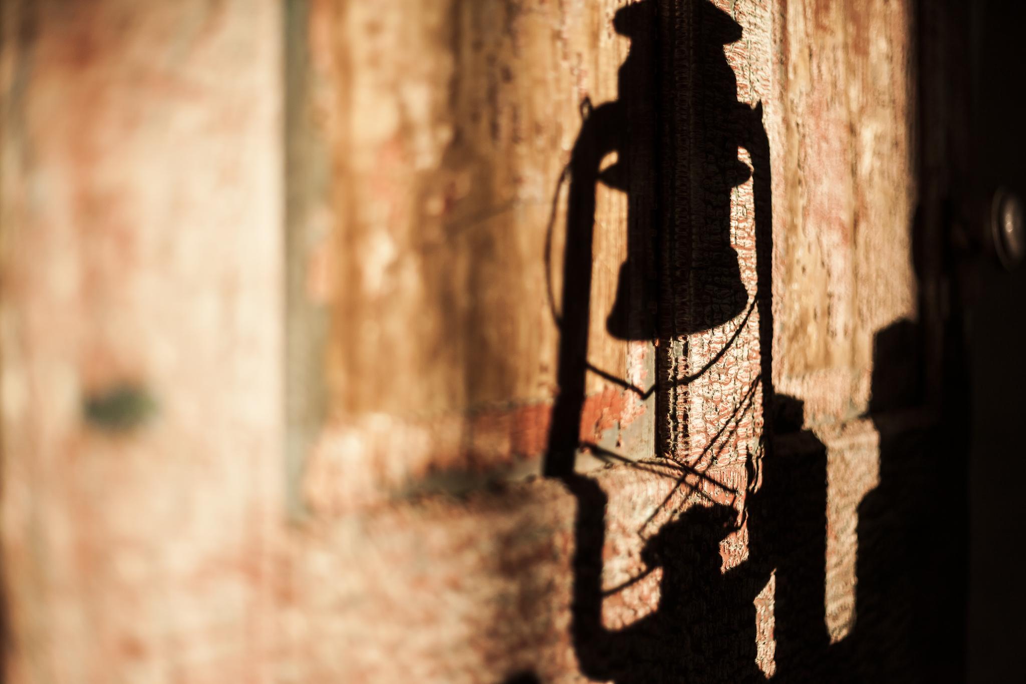 Antique Door with a Coal Oil Lamp Shadow