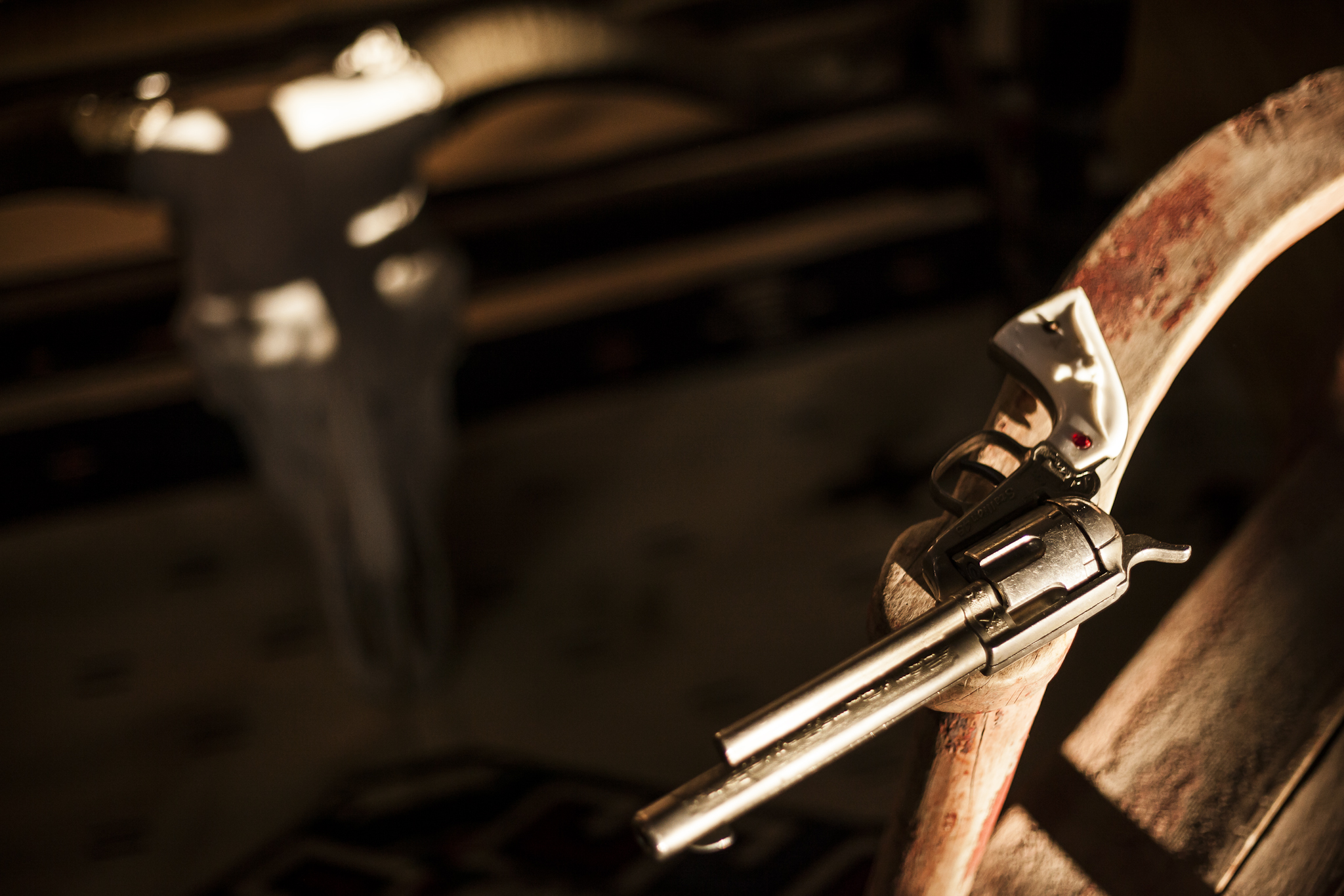 Antique Revolver on a Primitive Rocking Chair