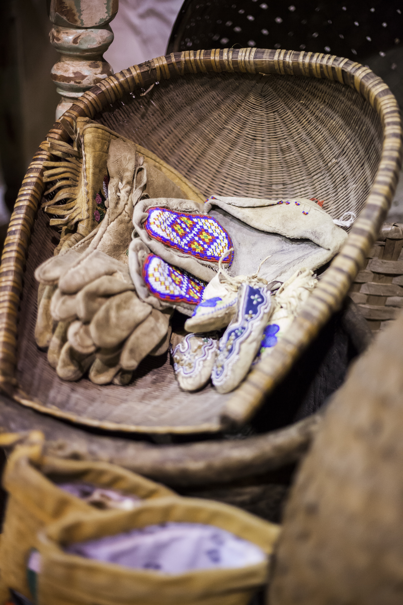 Antique Native American Beaded Gloves in a Handwoven Basket with Mockasins