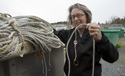 Jan Straley of the Sitka Sound Science Center with whale deterrent gear.