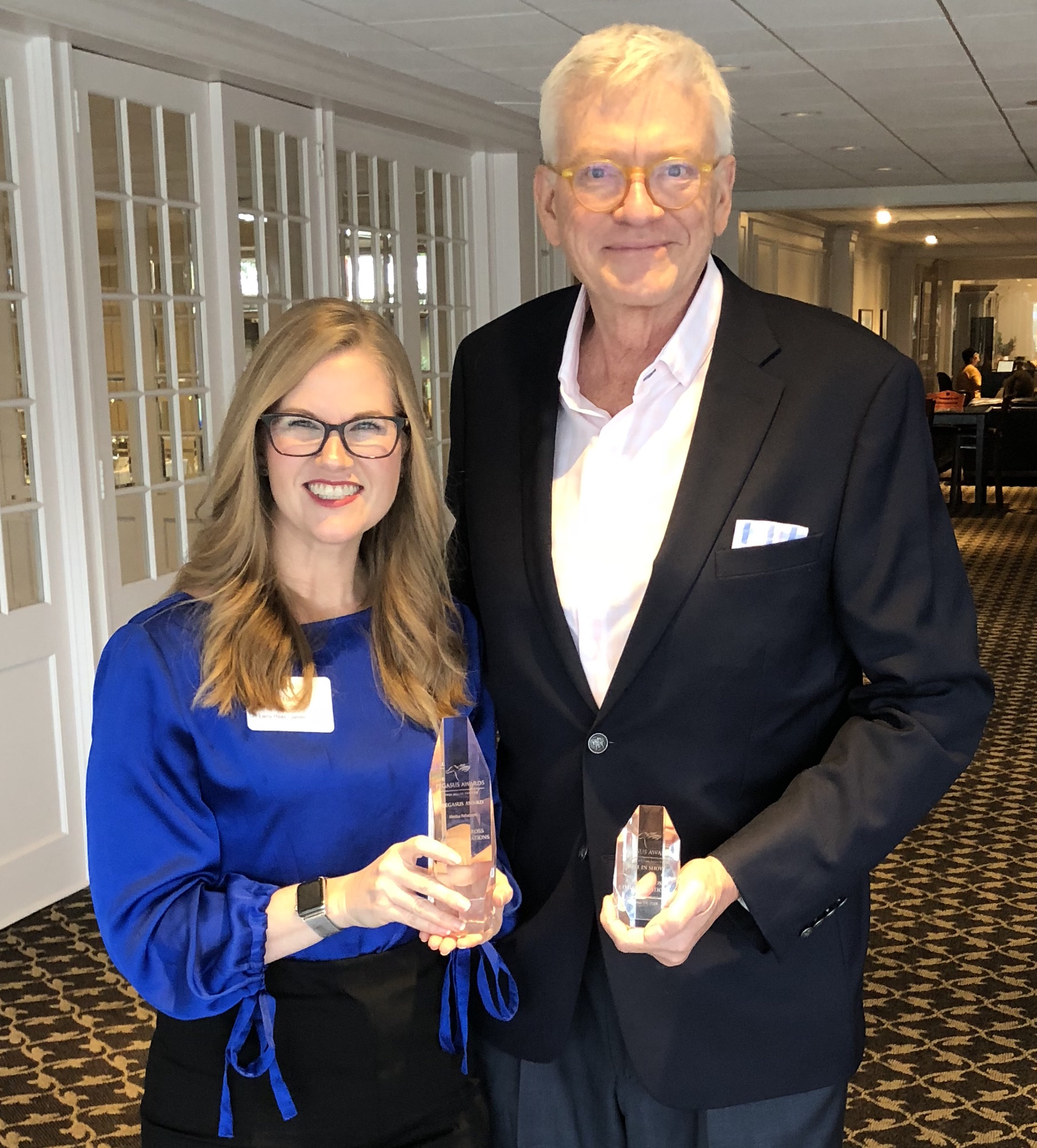 """Vice President of Account Services Kristin Cole and President A. Larry Ross accept the 2018 PRSA Dallas Pegasus Awards for """"Projects Best in Show"""" and """"Media Relations, Consumer"""" on behalf of A. Larry Ross Communications. (A. Larry Ross Communications)"""