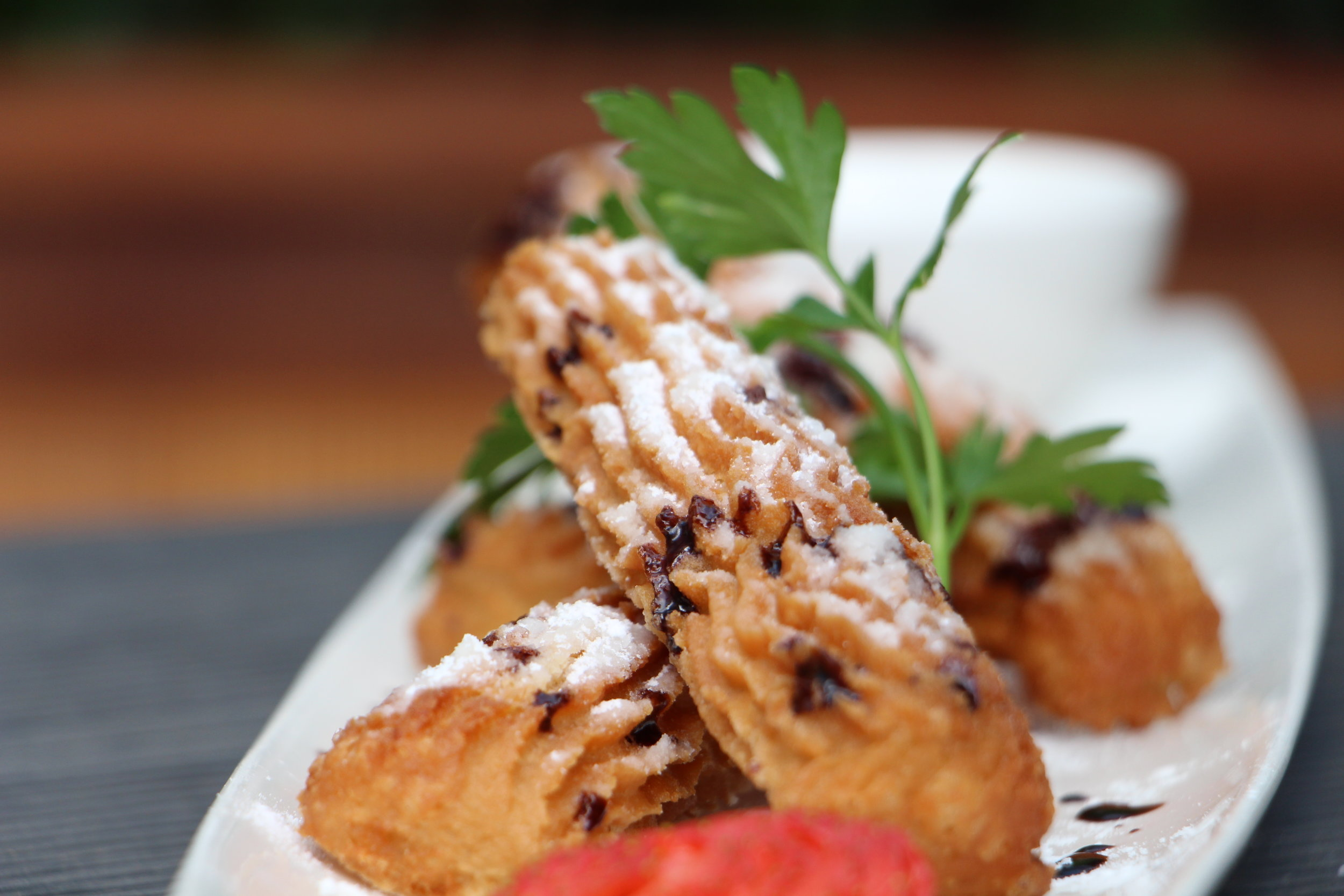 Spanish finger donuts of deep-fried choux pastry coated in a cinnamon-sugar mixture will leave you licking your fingers wanting more, especially with our moreish chocolate dipping sauce.