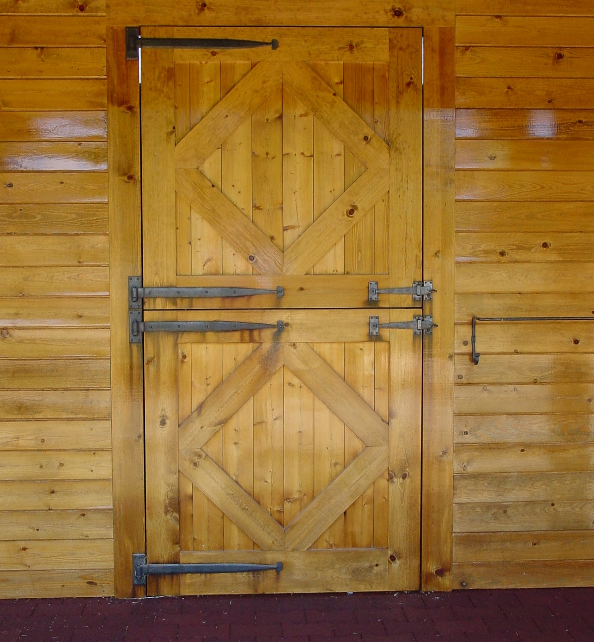 "Both the barn and stall dutch doors are custom built pine with custom designed,  h  and-forged iron , period strap hinges and one of a kind latches and blanket rails. The interlocking rubber aisle way pavers are 1-3/4"" thick."