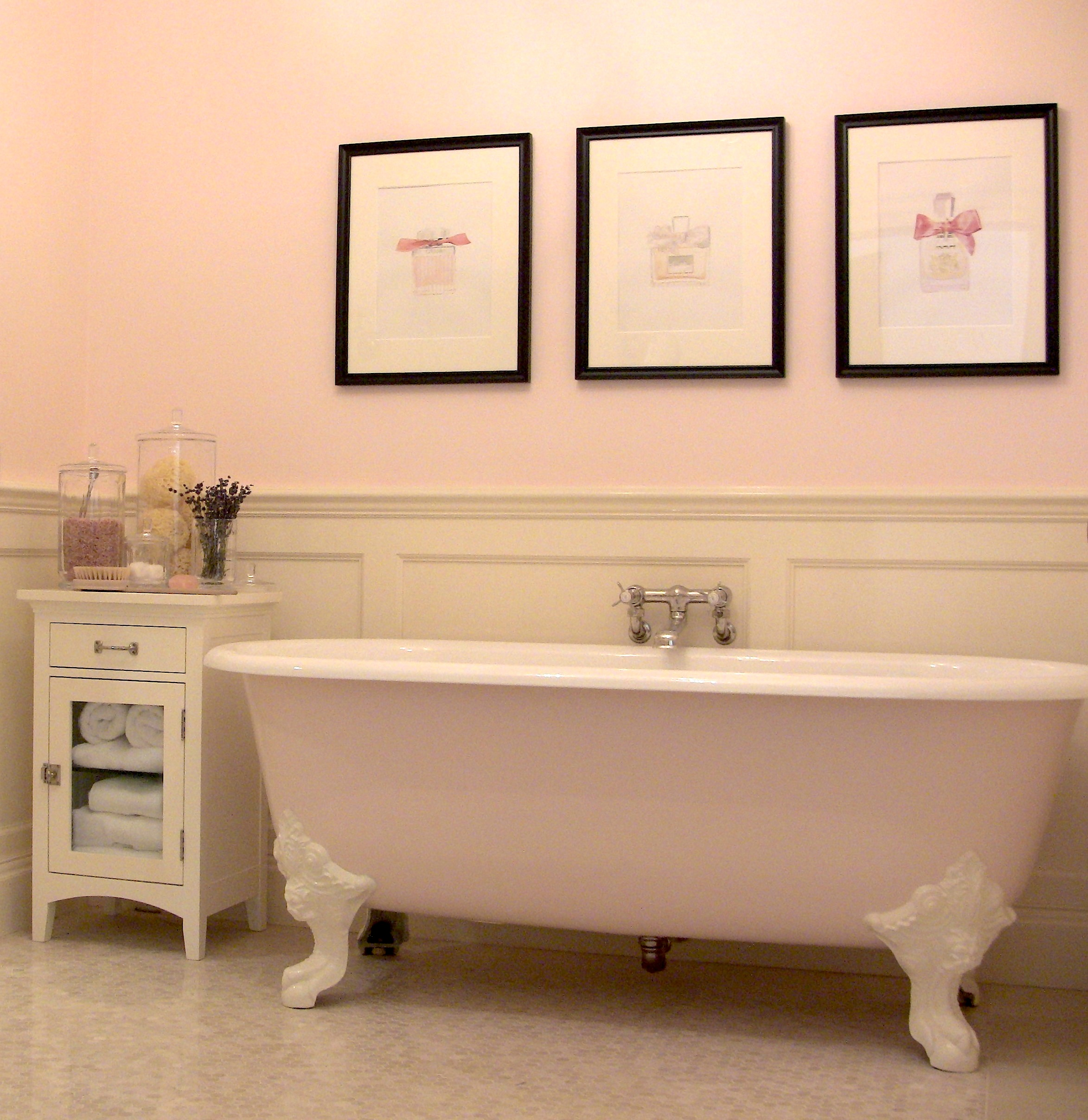 Bathroom for the bedroom above includes an imported English cast iron claw-footed tub