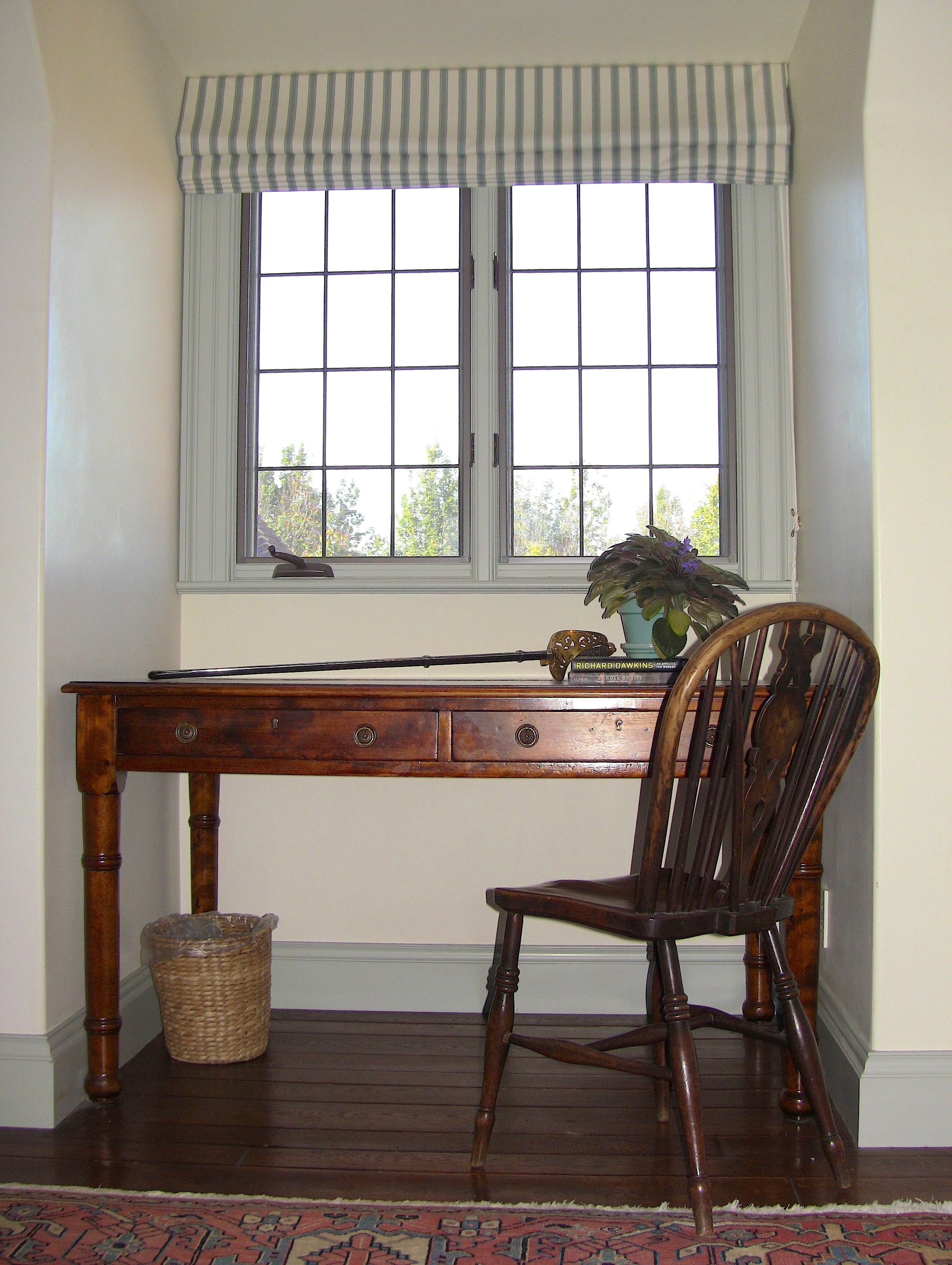 On the Northwest side of the room, a dormer window accommodates perfectly an antique study desk.