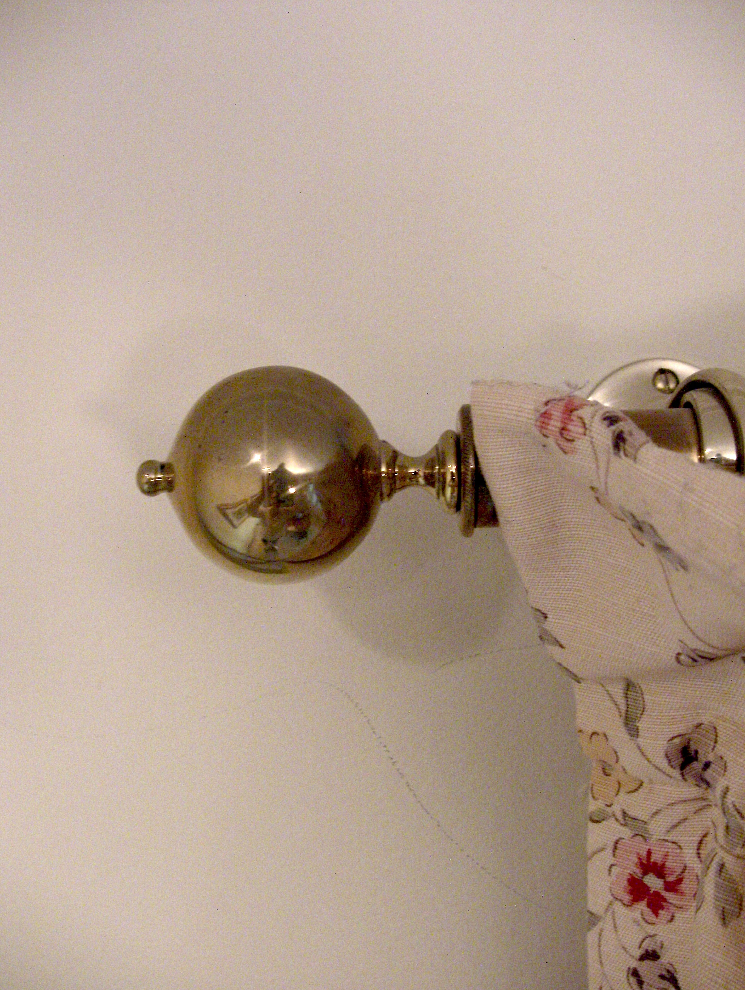 Brass curtain rods in the Morning Room and throughout the house are tipped with reproduction brass finials. Each is a clone of an original antique and were made in Buxhill, England by Brass Foundry Castings Ltd.