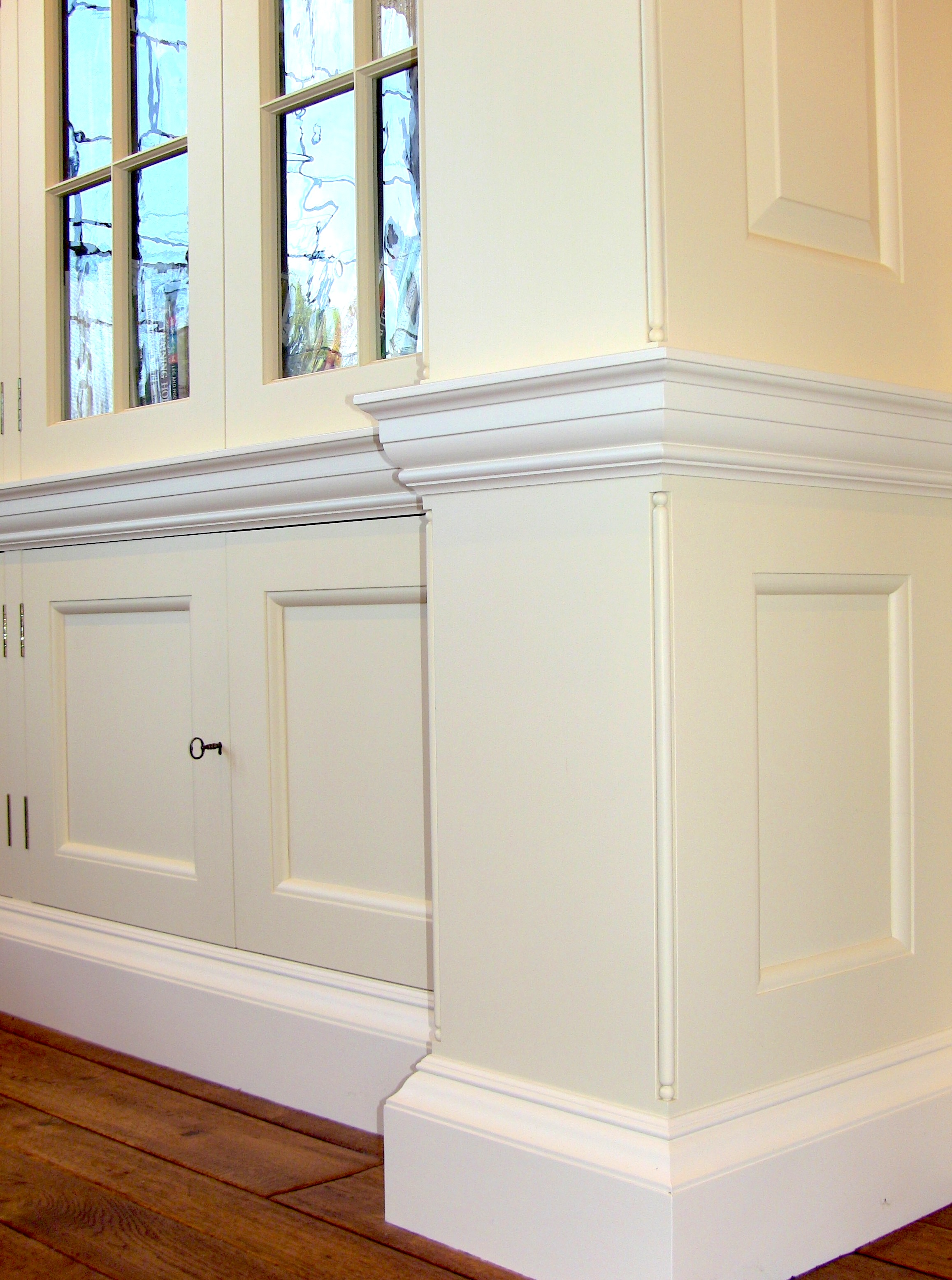 """Notice the beautiful texture of the hand blown glass.All the cabinet doors are accessed via keyed antique-style half-mortise furniture locks.  The floor to ceiling paneling in the Drawing Room, Library and Music Room is an exact reproduction of the paneling Lutyens designed for """"Temple Dinsley"""" in Hertfordshire during 1909."""