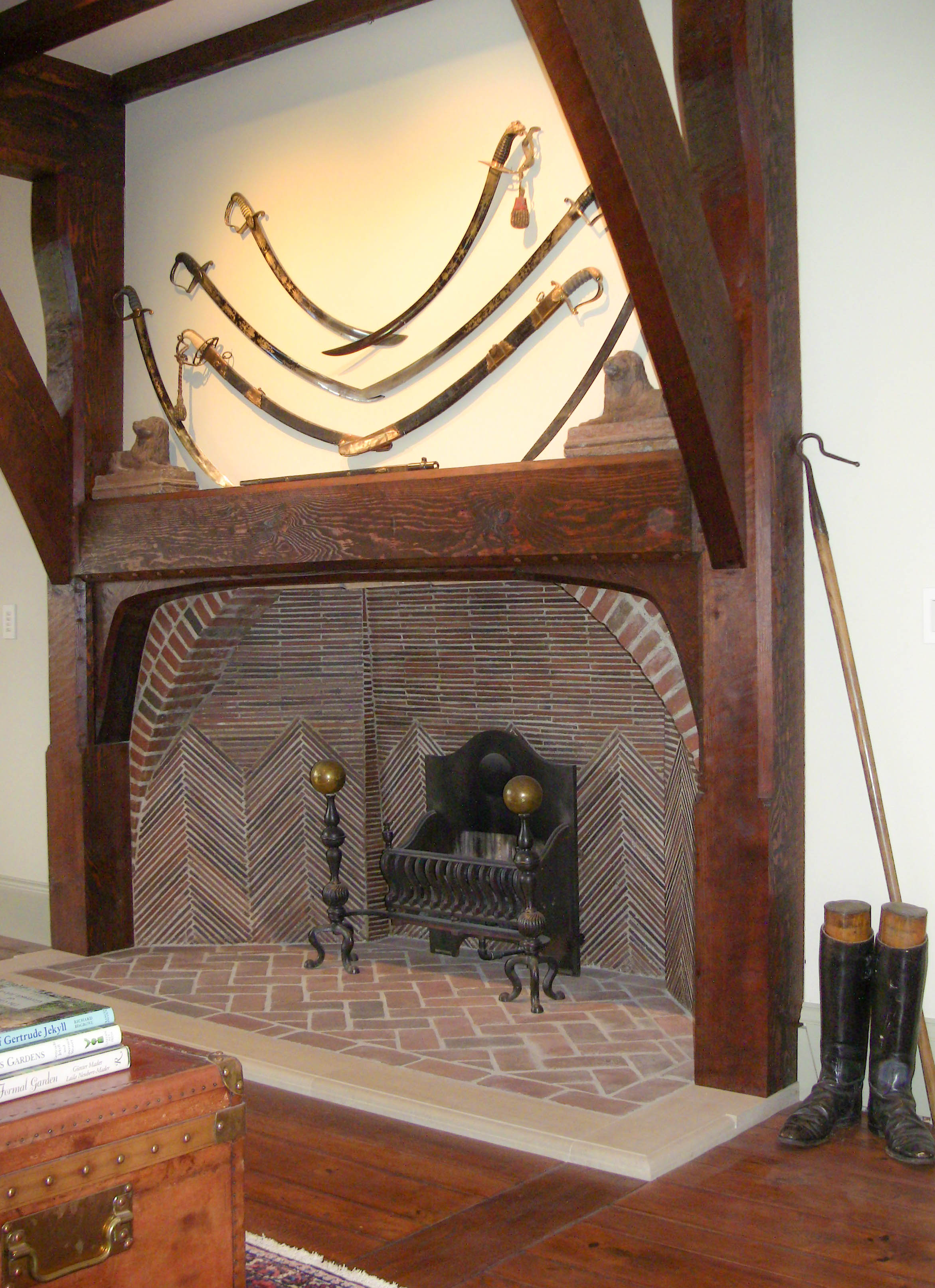 """The Great Room fireplace is a reproduction of Lutyens'Hall fireplace at """"Deanery Garden"""" in Sonning, England. The floors throughout are hand-scraped,imported European coppice oak."""