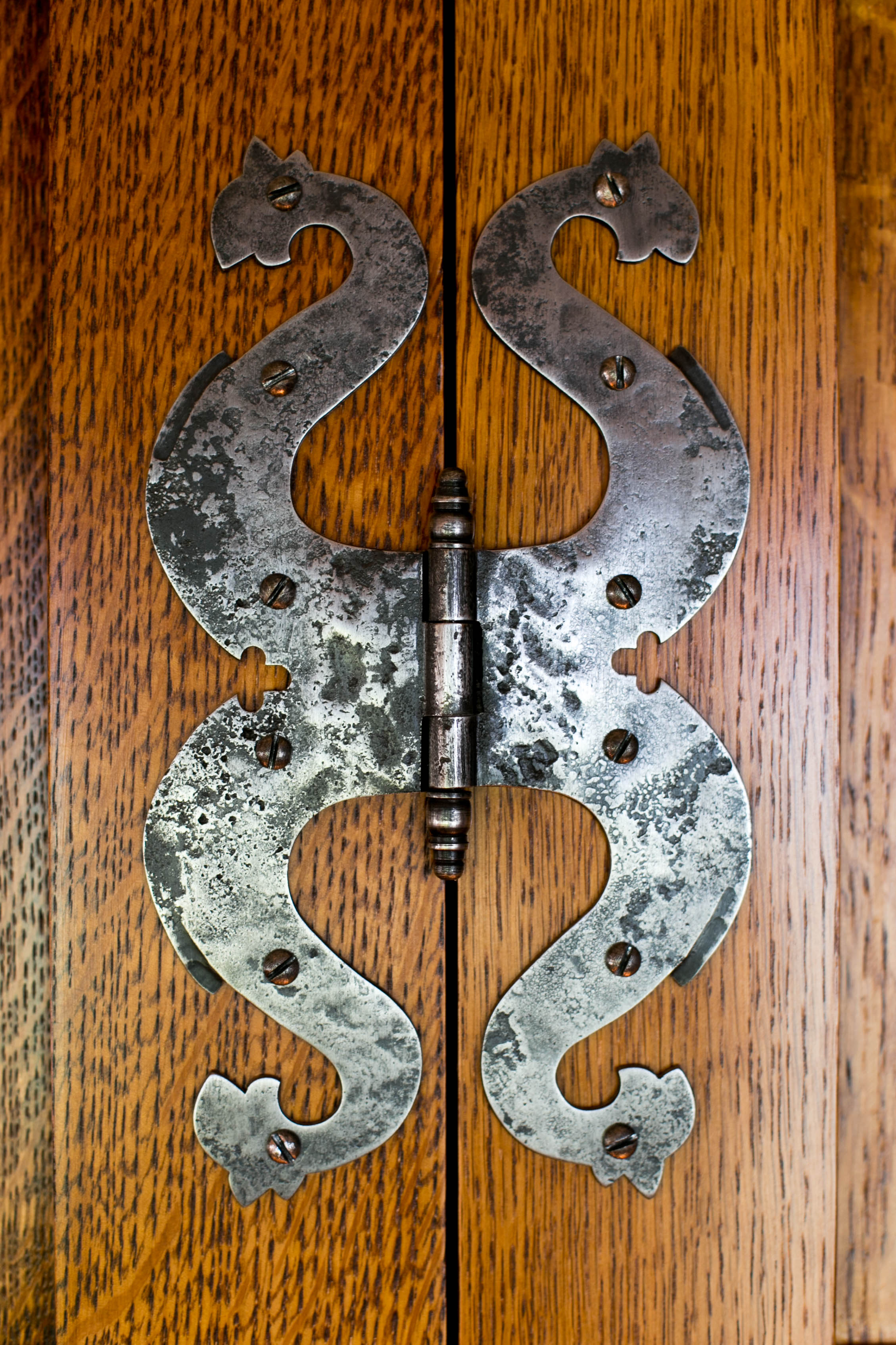 """Custom made reproduction dragon's head butterfly hinges. The paneling and hinges are replicas of the """"Best Dressing Room"""" at Lutyens' Castle Drogo."""