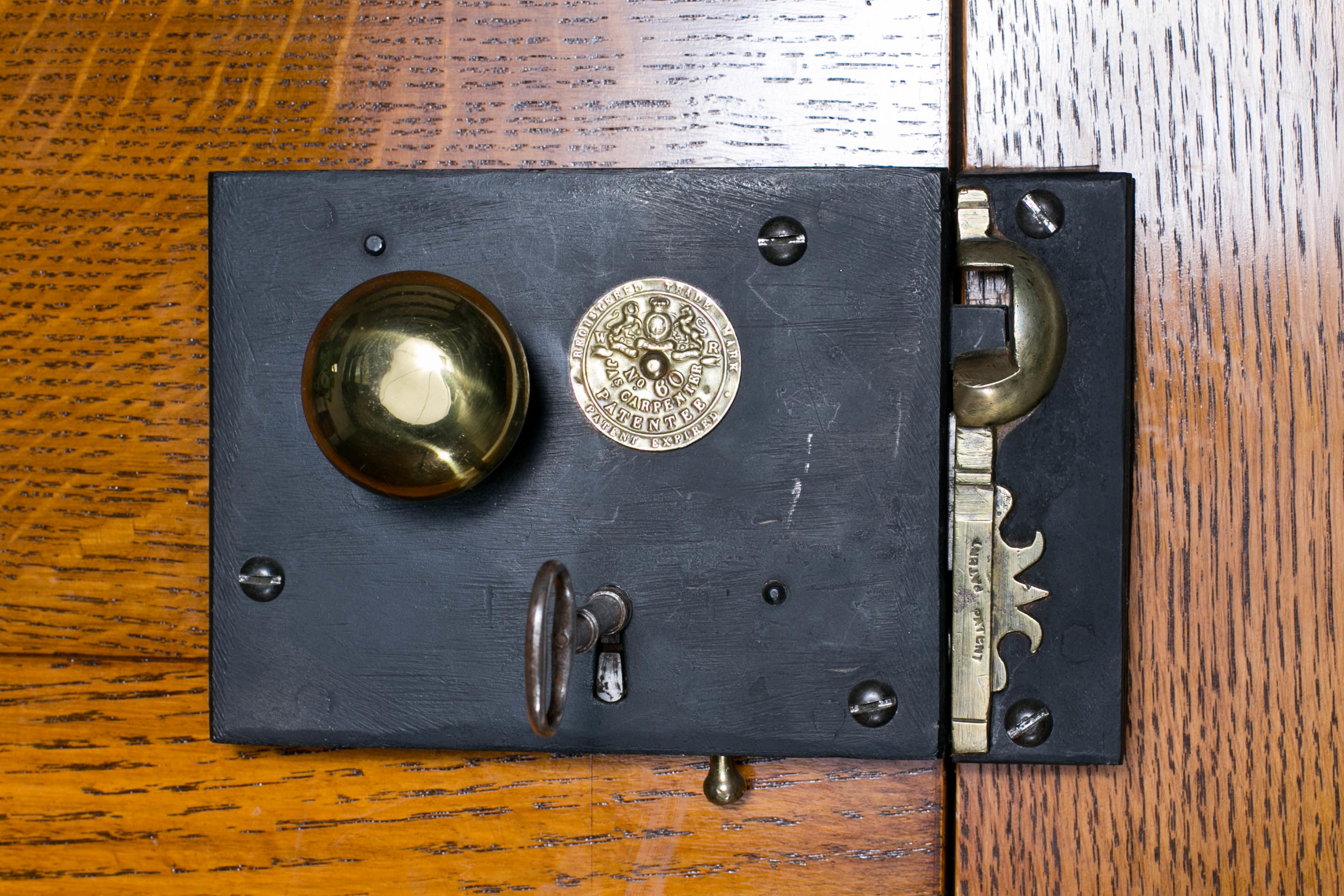 This antique Carpenter lock bears the coat of arms for King William IV who reigned Great Britain and Ireland between 1830 and 1837. This design was originally patented  by James Carpenter and began production in England in 1830
