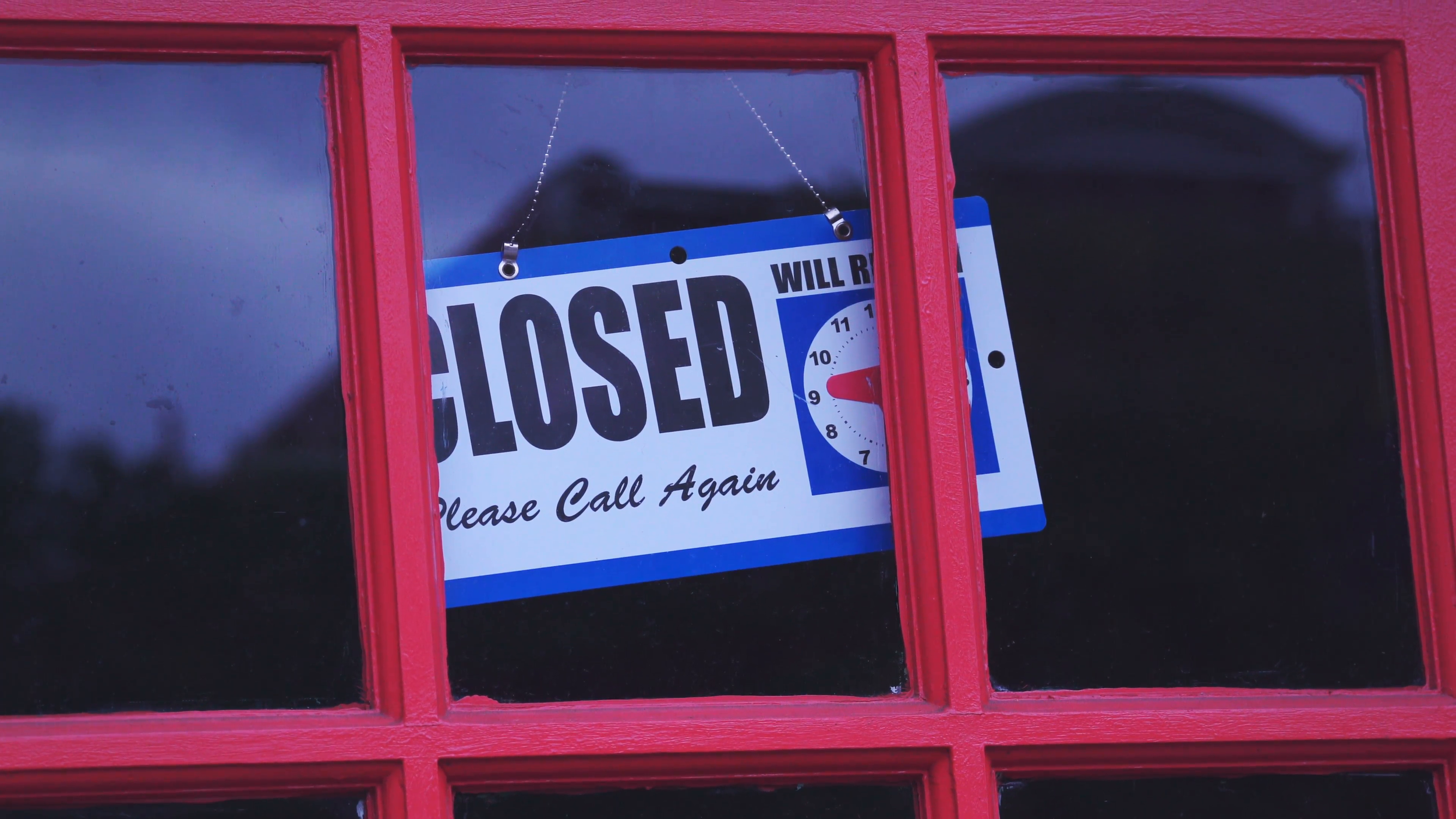store-closed-sign-hanging-on-red-painted-door_4ypdq41sl__F0000.png