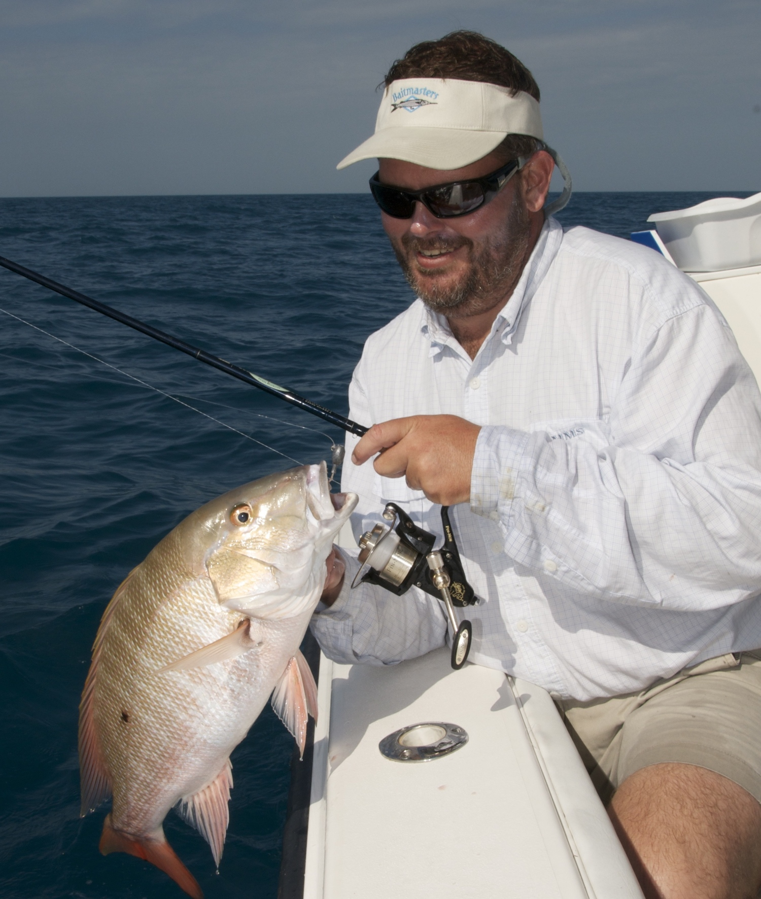 Capt. Ted Lund and a Key West mutton snapper on light tackle.