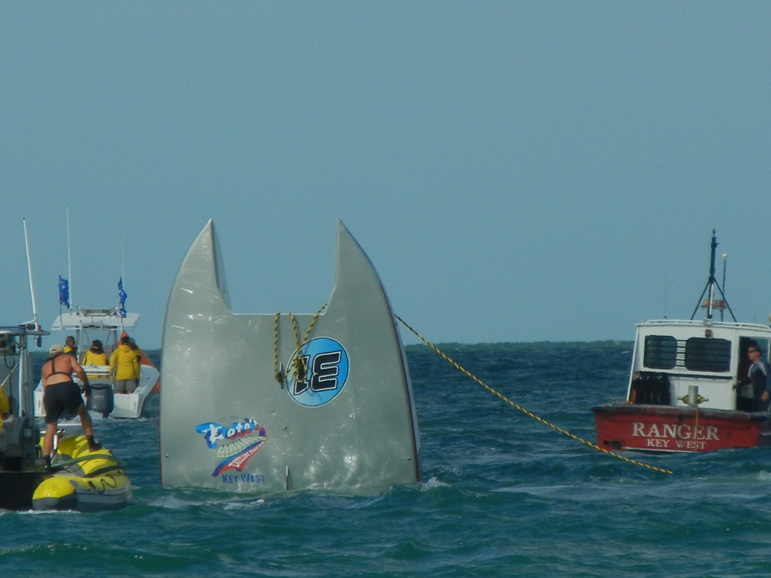 Salvage workers attempt to recover the Page Motorsports catamaran that flipped in the November 2011 SBI World Championships in Key West Harbor. Throttleman Joey Gratton was killed in the wreck.