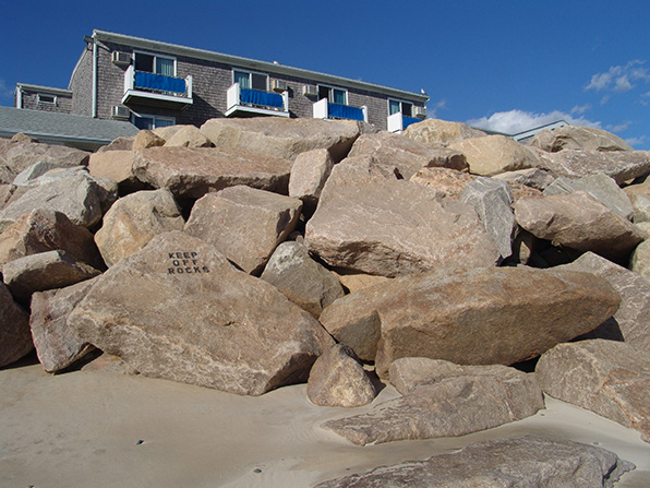 Rates of beach erosion along the Westerly shoreline are increasing, prompting the need to relocate some buildings, even those 'protected' by a wall of boulders. (Frank Carini/ecoRI News)