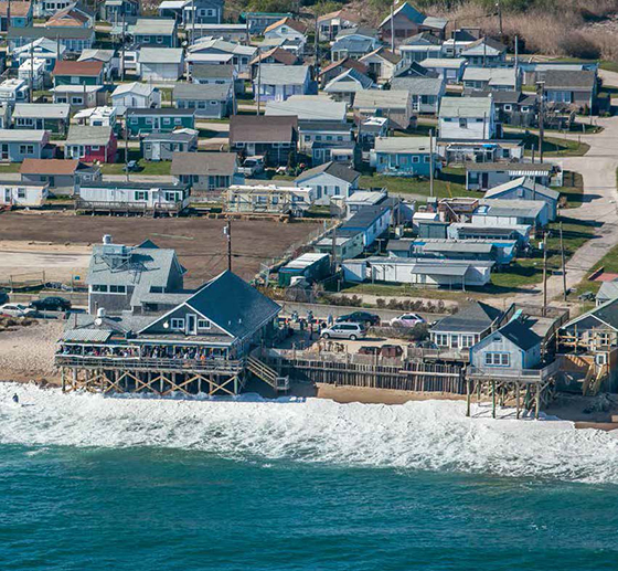 Ocean Mist, the waterfront bar in Matunuck, and many of the buildings along the popular beach are losing land to a rising sea. (©John Supancic/for R.I. Sea Grant)