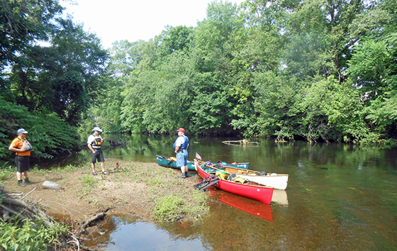The group takes a break along the Pawtuxet River.