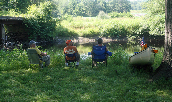Taking a break along the Pawcatuck River in Westerly.