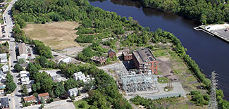 The former Tidewater Street gasification plant in Pawtucket is boarded by residential properties, three schools and the Seekonk River. (National Grid)